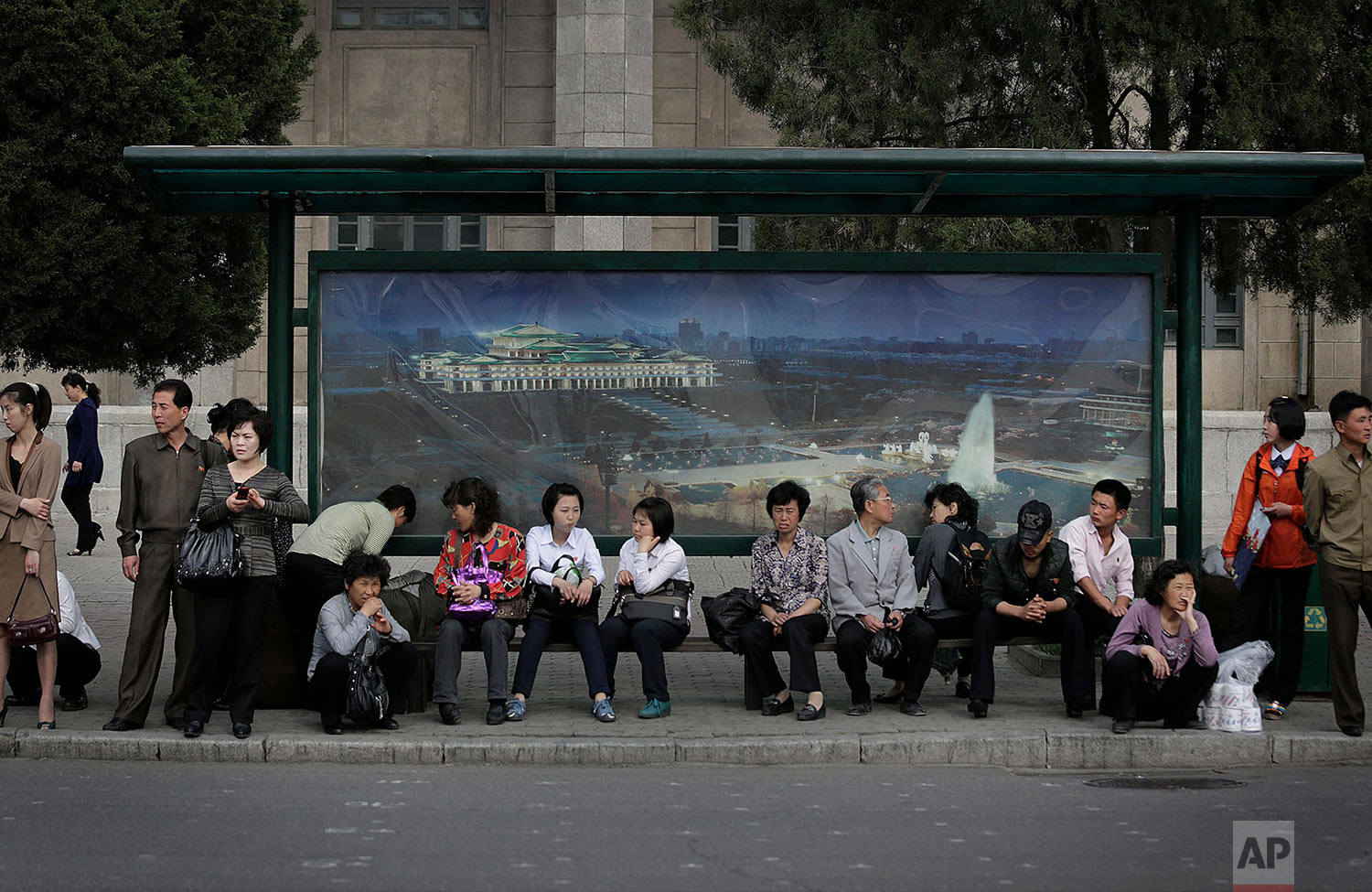 Commuters wait for a trolley bus to arrive in downtown Pyongyang, North Korea, on May 3, 2015. (AP Photo/Wong Maye-E)