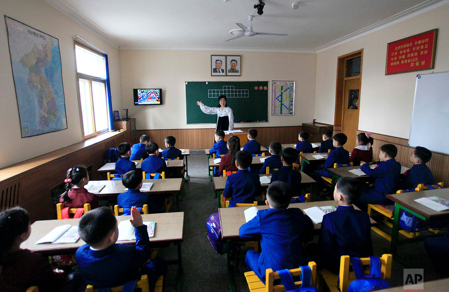 Students attend their first day of class at the Ryonhwa primary school in Pyongyang, North Korea, on April 2, 2018. (AP Photo/Jon Chol Jin)