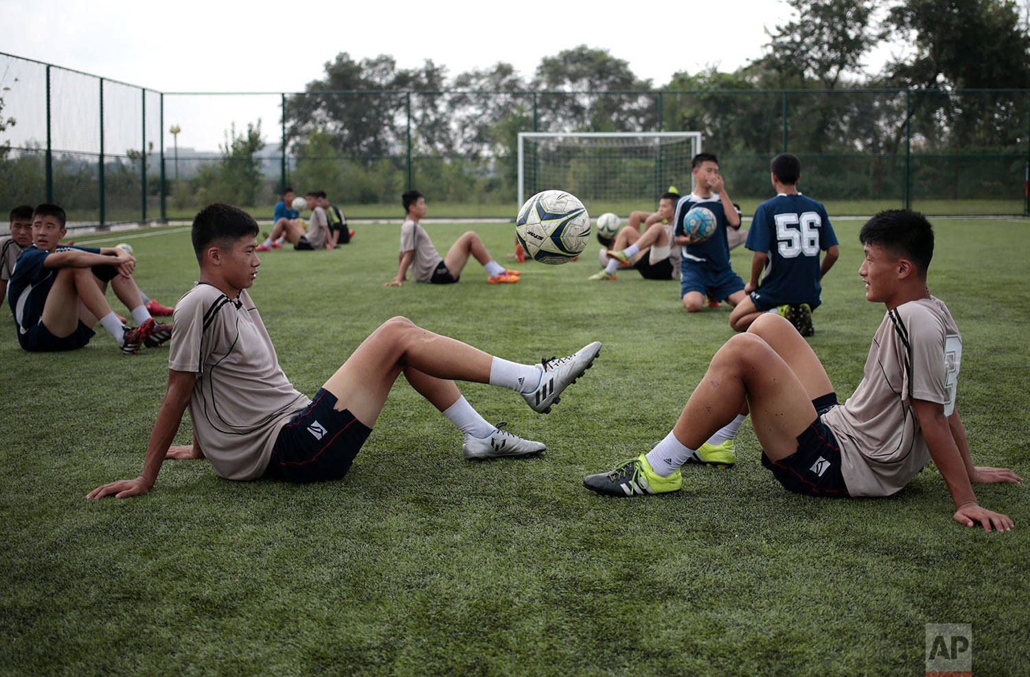 Youths play with a ball during a break at Pyongyang International Football School in Pyongyang, North Korea, on Aug. 24, 2016. North Korea has poured funds into the development and training of promising athletes over the past several years in an effort to fulfill one of leader Kim Jong Un's primary goals to become a country be reckoned with on the global sports stage. (AP Photo/Dita Alangkara)
