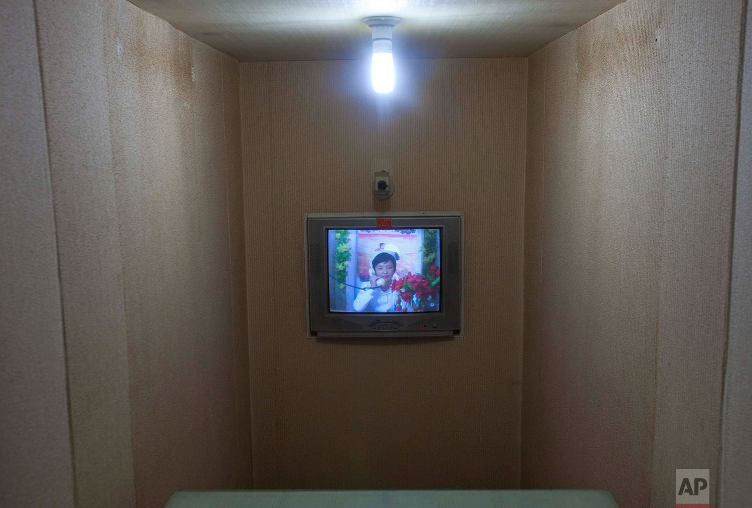 A North Korean nurse speaks by video conference and telephone to a doctor inside a maternity hospital in Pyongyang, North Korea, on Oct. 11, 2011. (AP Photo/David Guttenfelder)