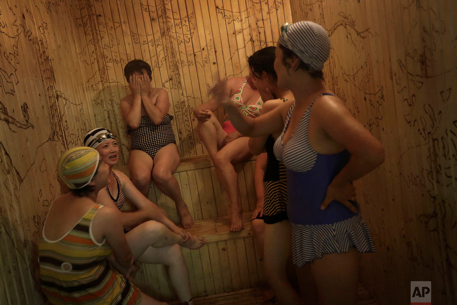 Women who work at the Kim Jong Suk Pyongyang textile factory spend their free time in a sauna at their dormitory in Pyongyang, North Korea, on July 31, 2014. This is the country's largest textile factory with 8,500 workers, and 80 percent of them are women. (AP Photo/Wong Maye-E)