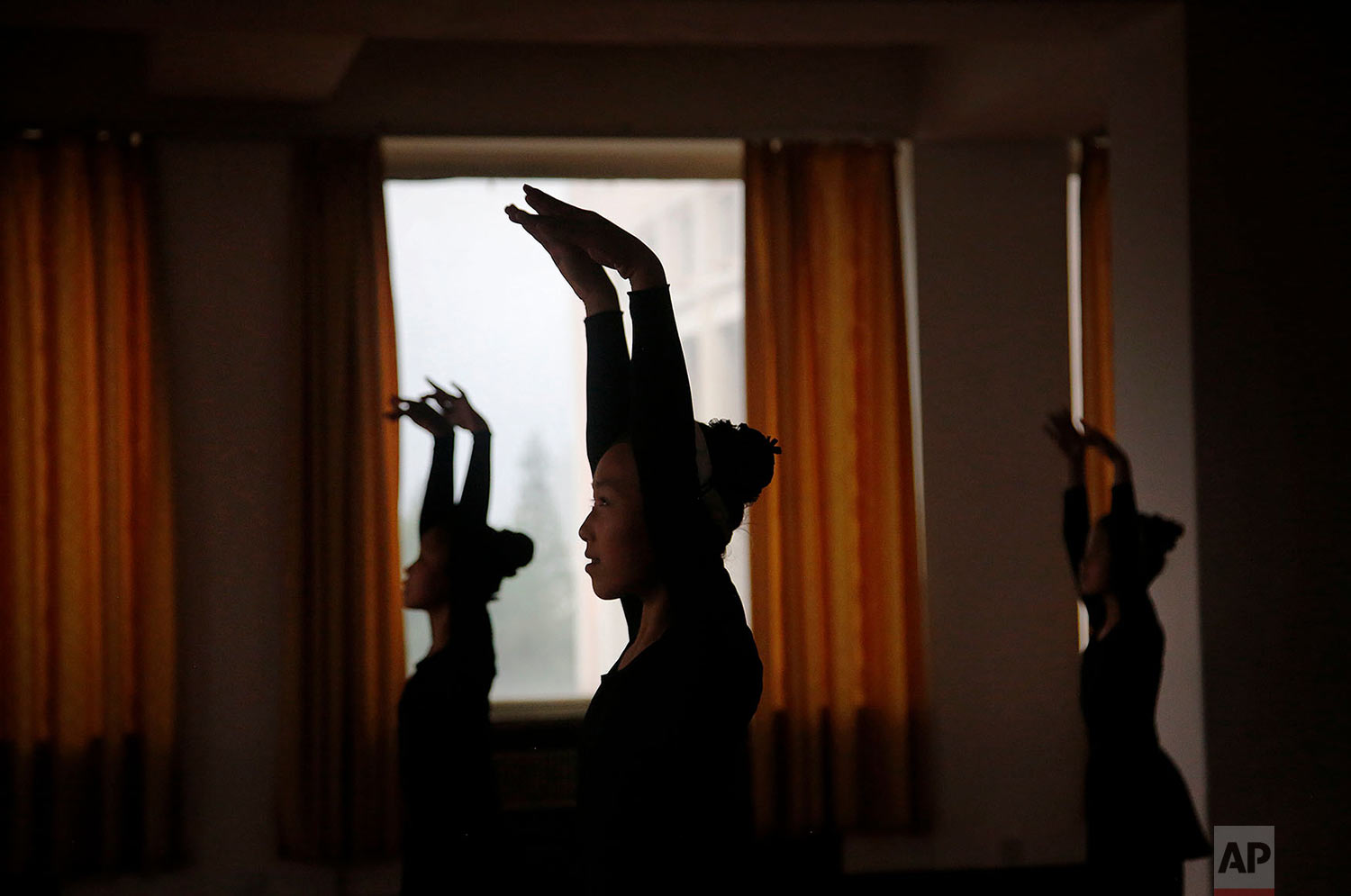 Girls are silhouetted during a dance class at the Mangyongdae Children's Palace in Pyongyang, North Korea, on May 7, 2015. The Children's Palace is a place where talented school children go for extracurricular classes, and is one of the places tourists visit during their stay in Pyongyang. (AP Photo/Wong Maye-E)