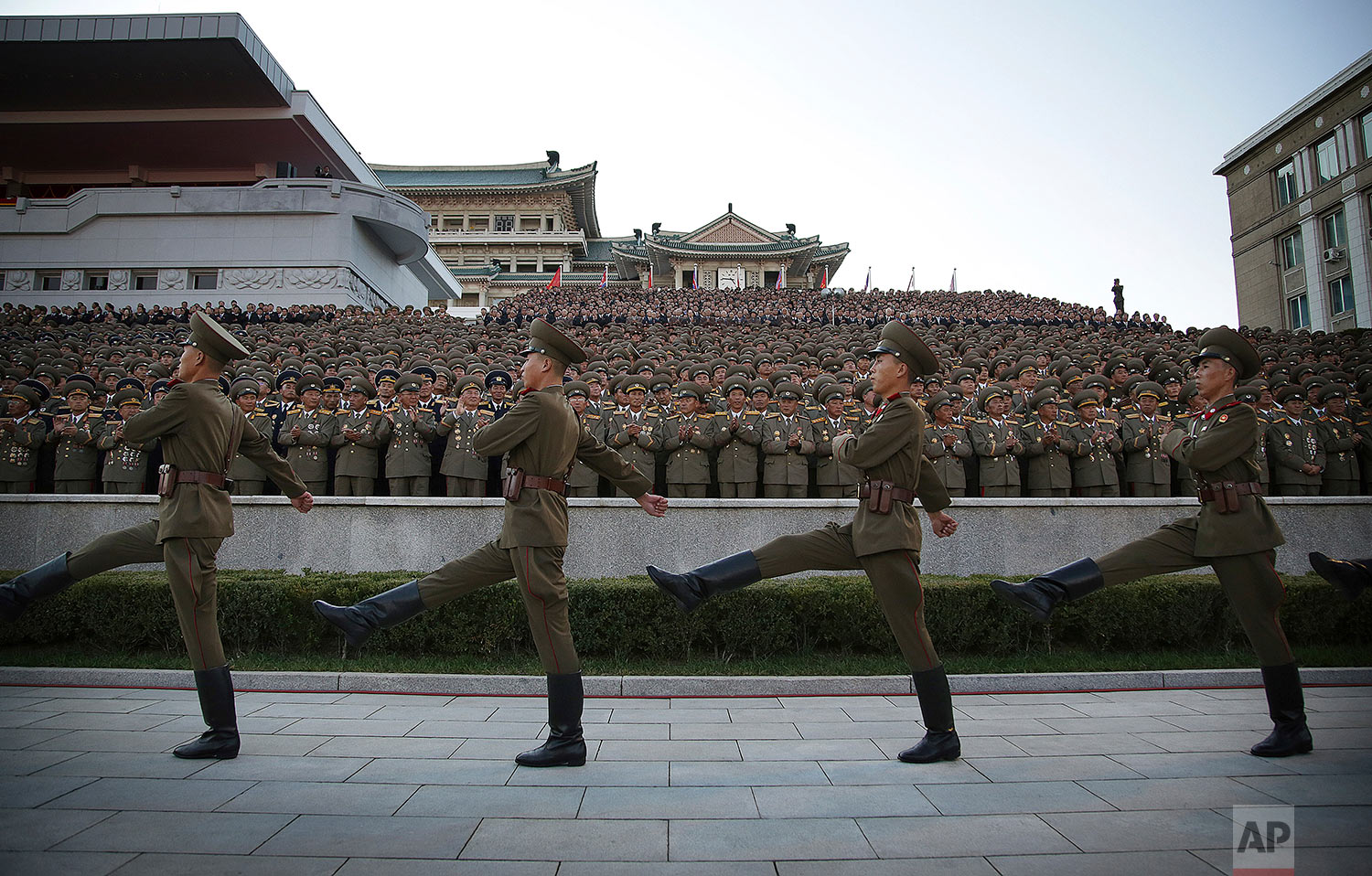 Soldiers march past veterans during a military parade in Pyongyang, North Korea, on Oct. 10, 2015. (AP Photo/Wong Maye-E)