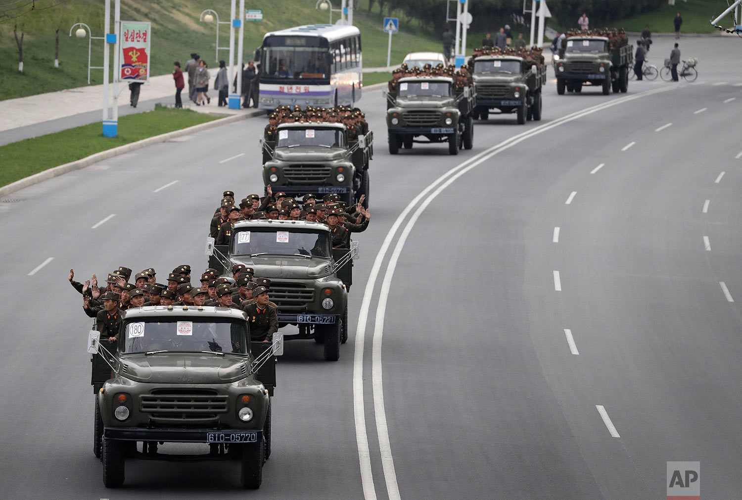 North Korean soldiers ride in the back of trucks as they drive down Mirae Scientists Street in Pyongyang on April 19, 2017, after participating in a military parade held to celebrate the 105th anniversary of the birth of the country's late founder, Kim Il Sung. (AP Photo/Wong Maye-E)