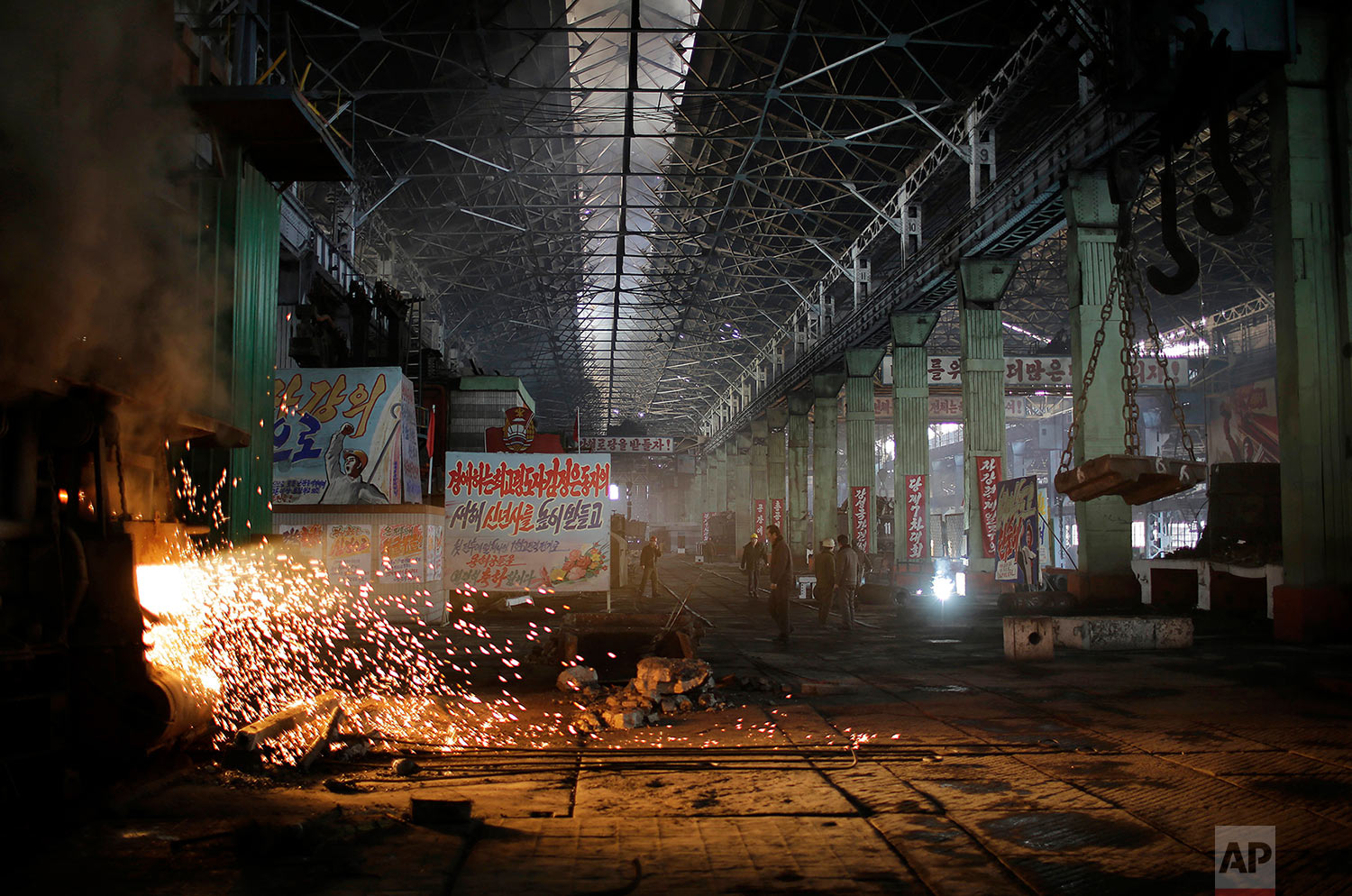 A shaft of light from a furnace shines through the Chollima Steel Complex in Nampo, North Korea, on Jan. 7, 2017. One of seven North Korean steel works, Chollima has more than 8,000 workers and is among the North's showcase enterprises. (AP Photo/Wong Maye-E)