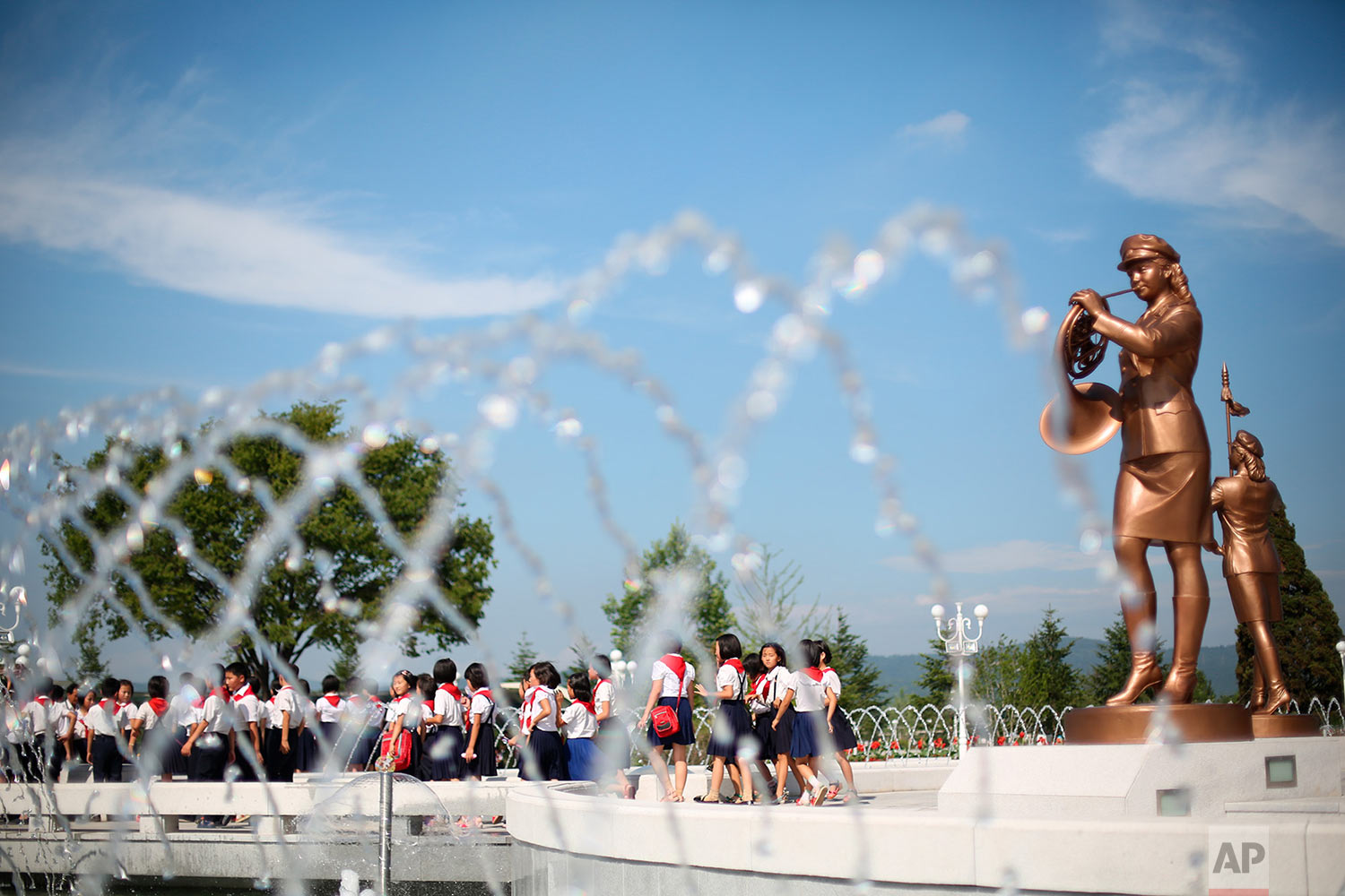 School children tour the park surrounding Kumsusan Palace of the Sun, the mausoleum where the bodies of late leaders Kim Il Sung and Kim Jong Il lie embalmed, in Pyongyang, North Korea, on Thursday, July 25, 2013. (AP Photo/Wong Maye-E)