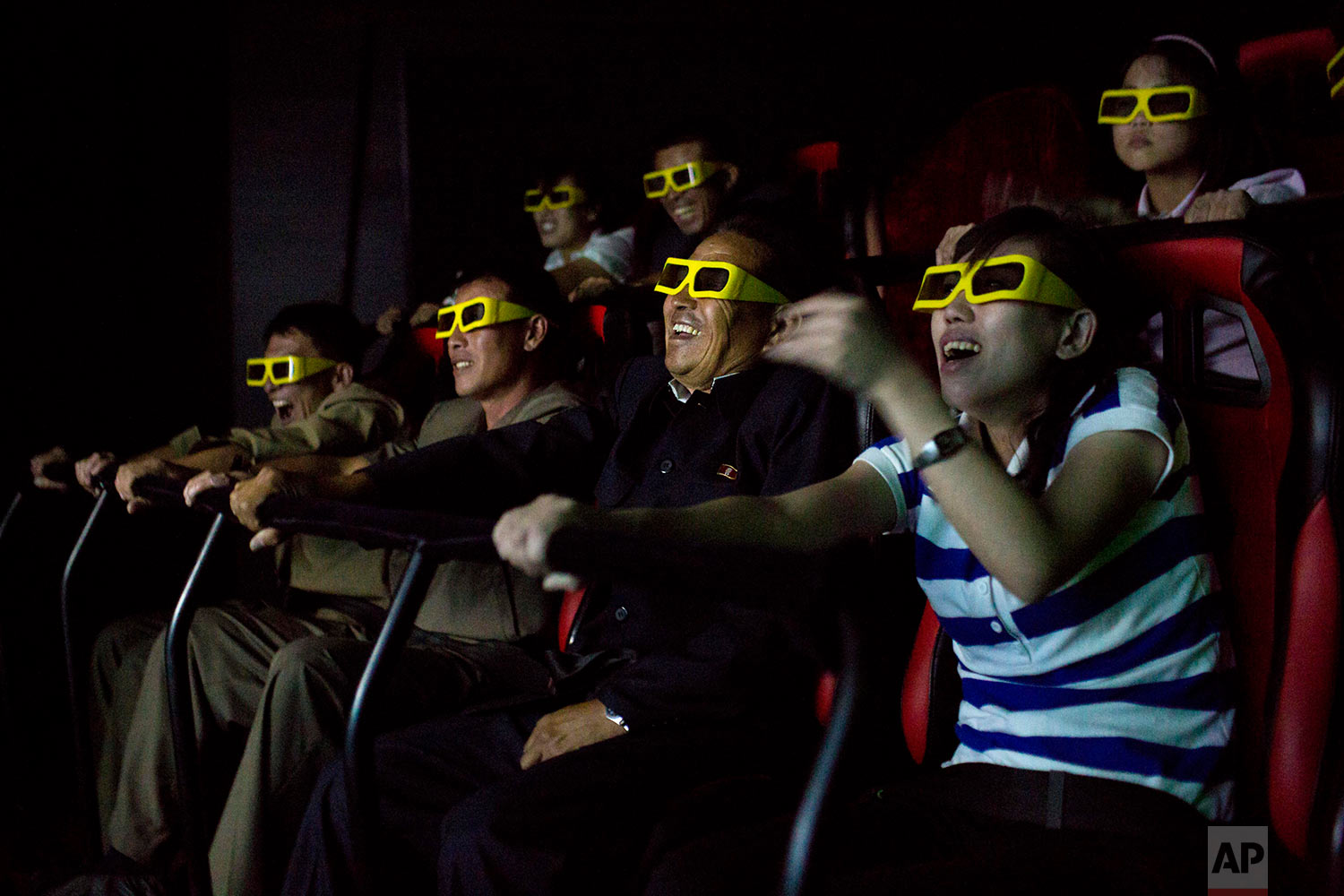 People watch a 3D movie on an amusement park ride at the Rungna People's Pleasure Park in Pyongyang, North Korea, on Sept. 22, 2013. (AP Photo/David Guttenfelder)