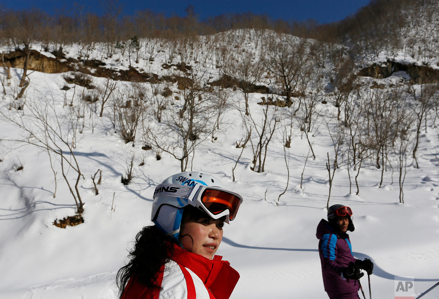 A man and woman ski at the Masik Pass ski resort, nestled deep in North Korea's eastern mountains, on Feb. 22, 2014. The resort has 10 ski runs, from beginning to advanced, a well-equipped rental shop, and a 250-room, eight-story hotel for foreigners alongside a 150-room hotel for Koreans. (AP Photo/Vincent Yu)