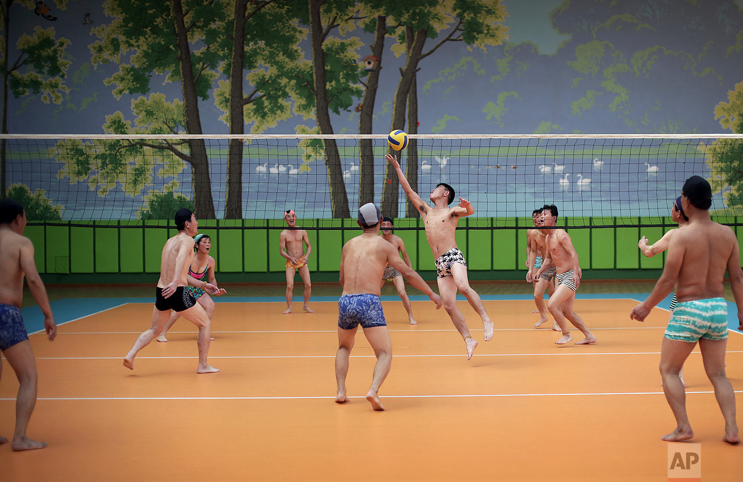 People dressed in their swim suits play volleyball at the Munsu water park in Pyongyang, North Korea, on Dec. 1, 2015. The water park is open to both tourists and locals living in the North Korean capital. (AP Photo/Wong Maye-E)