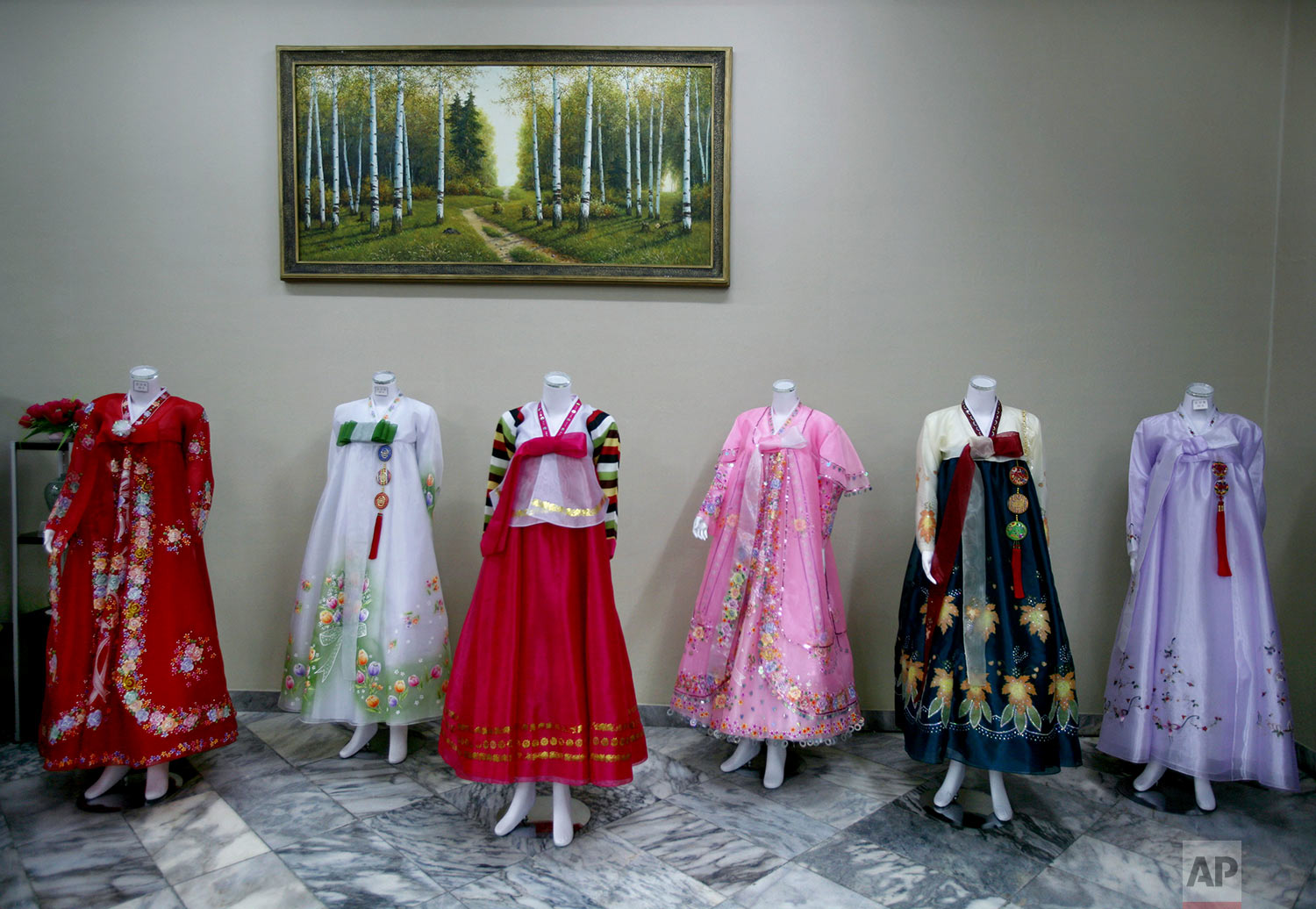 Dresses are displayed on mannequins at a hotel gift shop in Pyongyang, North Korea, on Feb. 27, 2008. (AP Photo/David Guttenfelder)