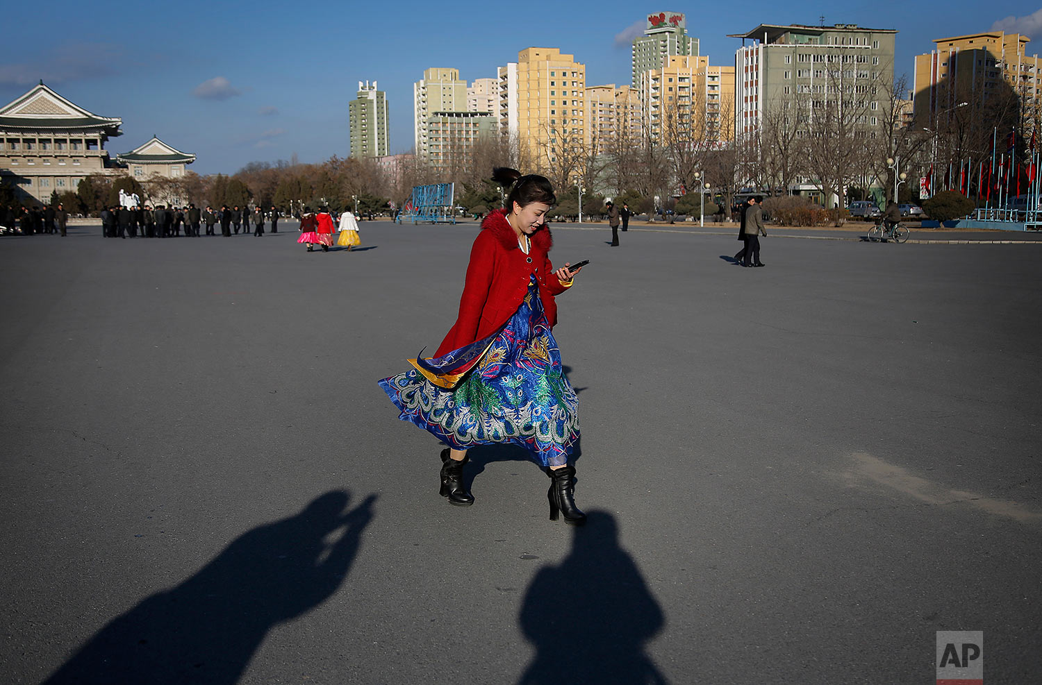 "A woman in a traditional dress leaves the Pyongyang Indoor Stadium after attending a mass dance party celebrating the ""Day of the Shining Star,"" or birthday of late North Korean leader Kim Jong Il, on Feb. 16, 2016, in Pyongyang, North Korea. (AP Photo/Wong Maye-E)"