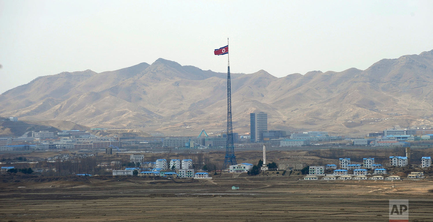 North Korea's flag flies on a tower high above the village of Ki Jong Dong, as seen from Observation Post Ouellette in the Demilitarized Zone, the tense military border between the two Koreas, in Panmunjom, Korea, on March 25, 2012. (AP Photo/Susan Walsh)