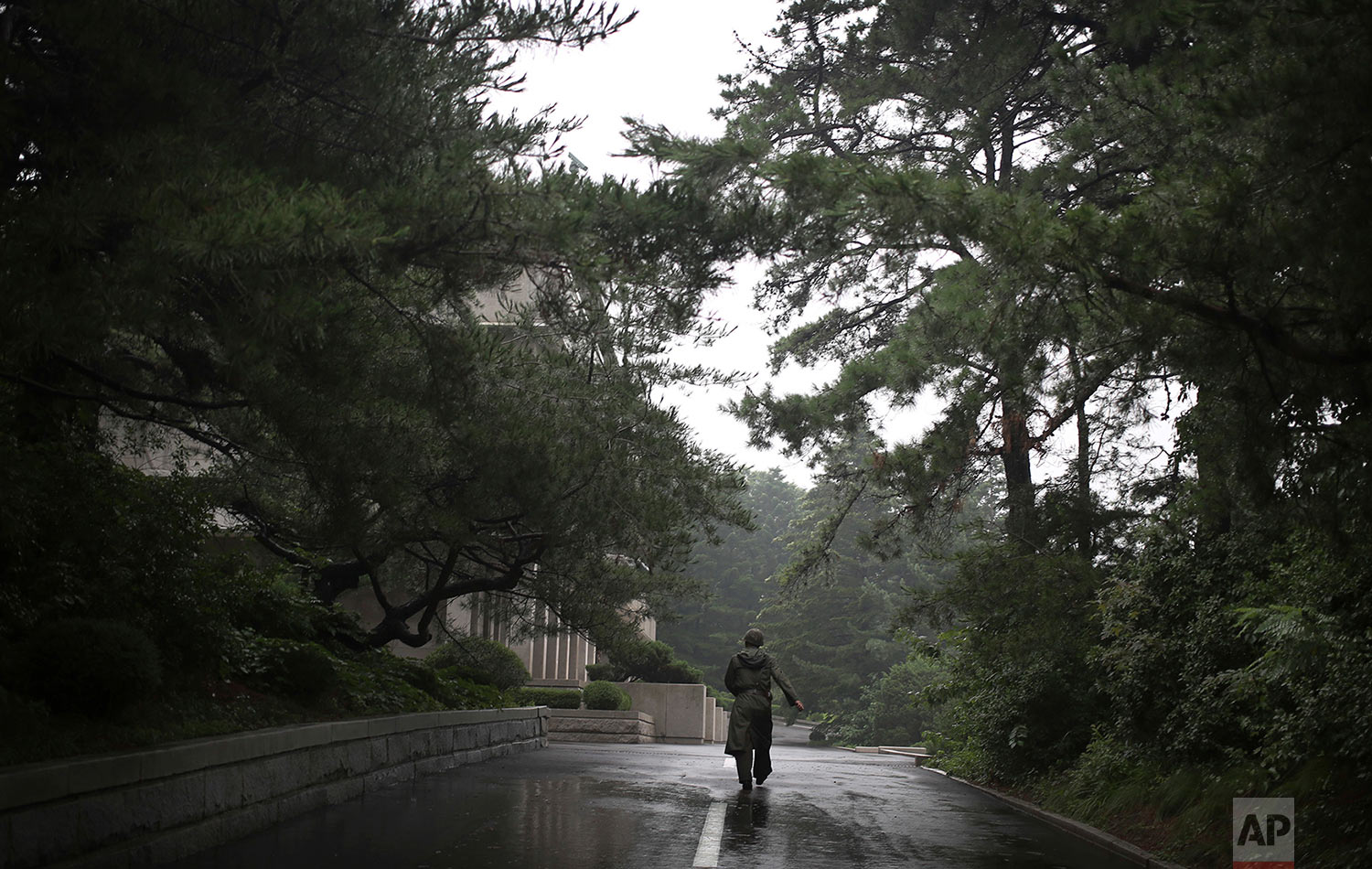 A soldier walks toward the truce village of Panmunjom on the North Korean side of the Demilitarized Zone that divides the two Koreas on July 22, 2013. (AP Photo/Wong Maye-E)