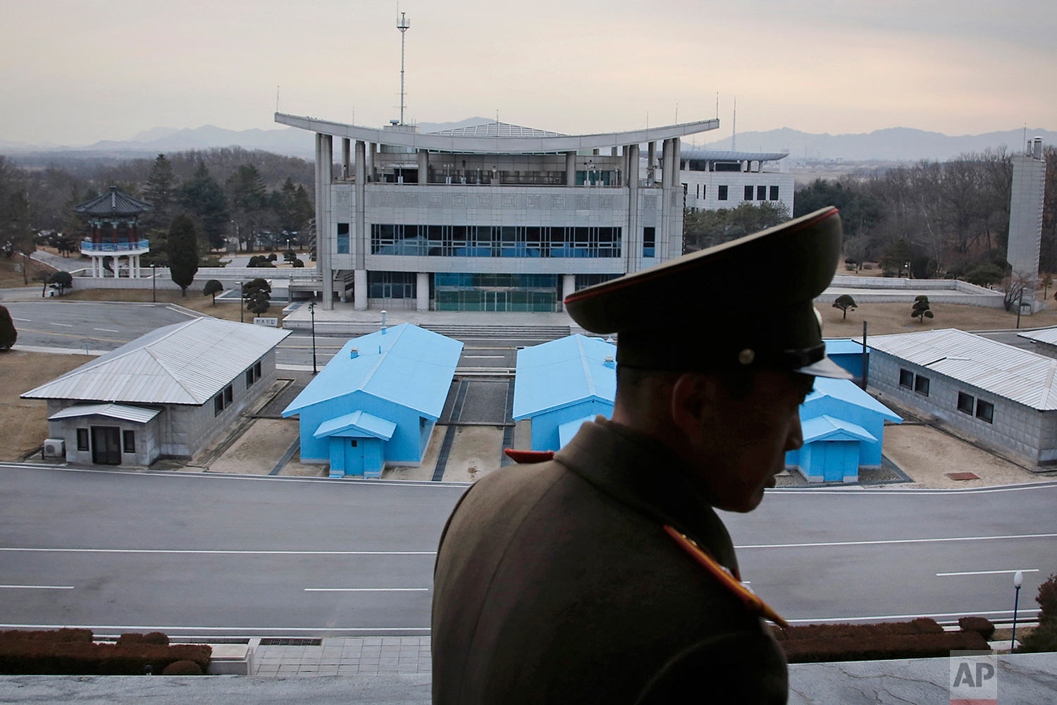 A North Korean army officer looks out at the Demilitarized Zone that separates the two Koreas in Panmunjom, Korea, on Feb. 22, 2016. (AP Photo/Wong Maye-E)