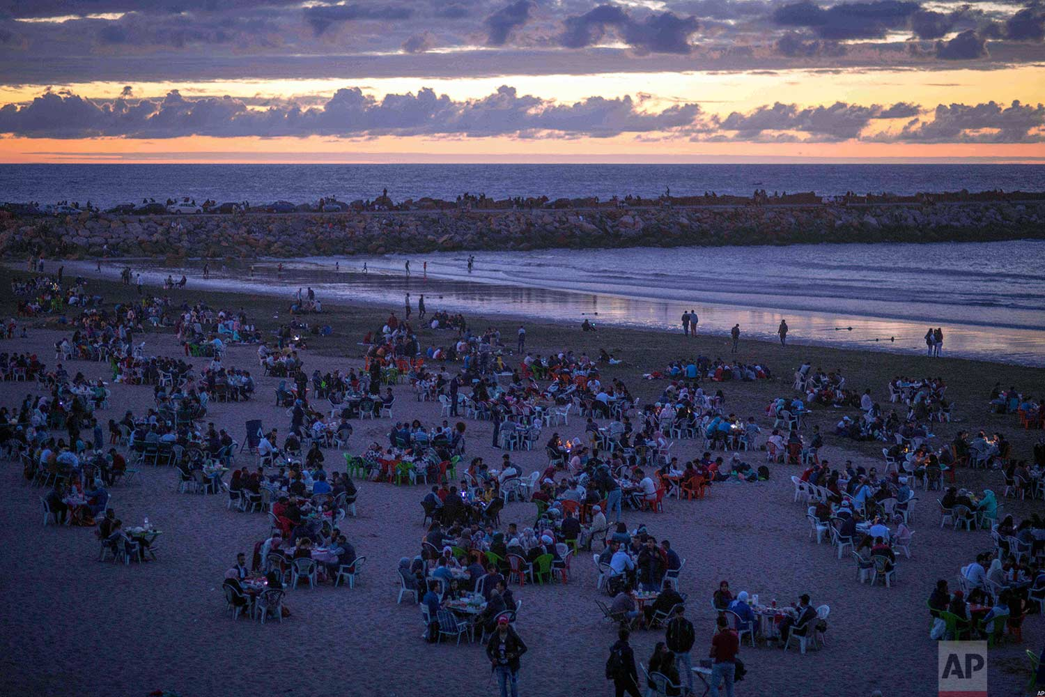 Friends and families gather to break their fast on the beach in the holy month of Ramadan, Rabat, Morocco, Saturday, June 9, 2018. (AP Photo/Mosa'ab Elshamy)