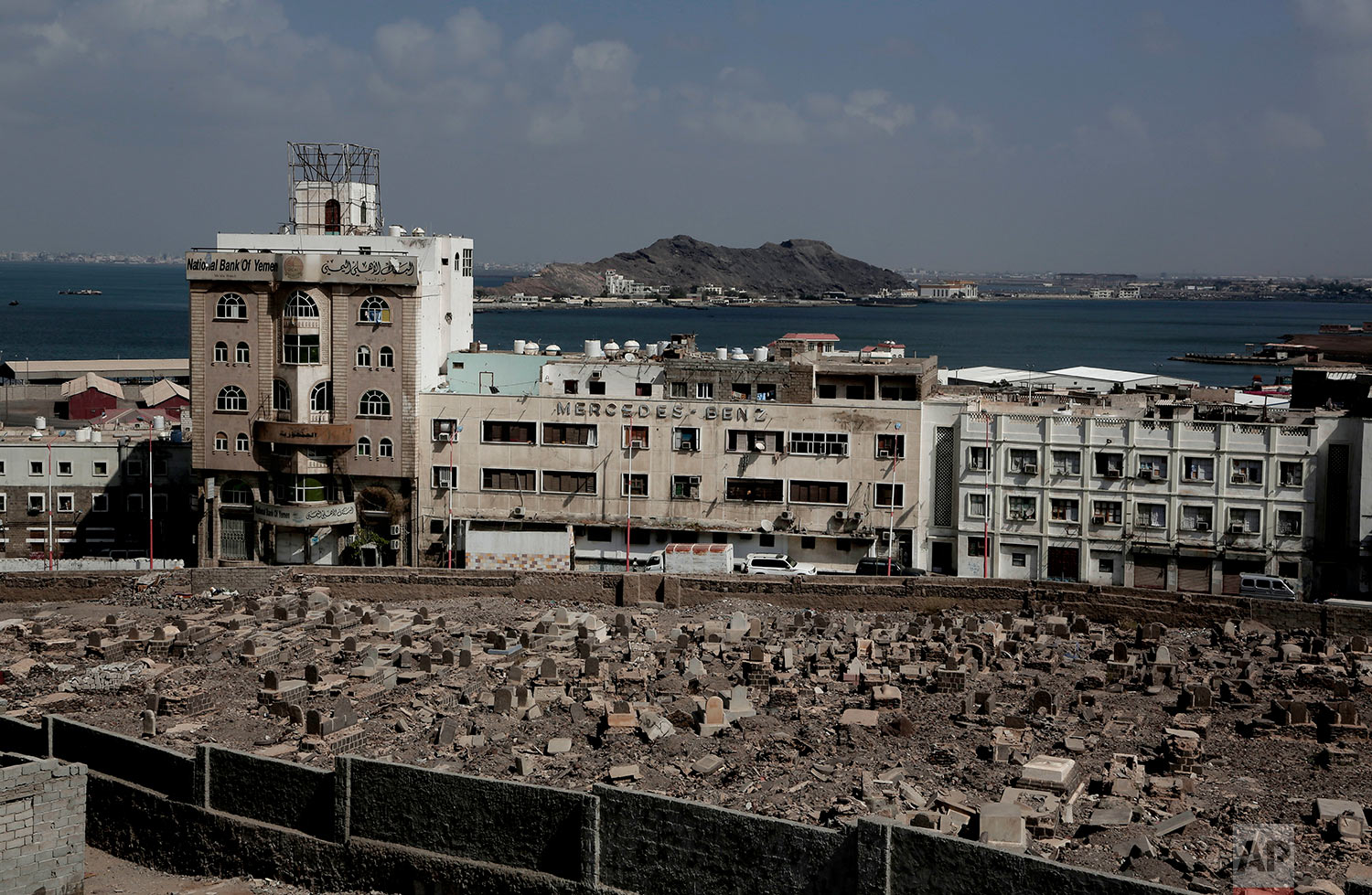 The Mercedes Benz building damaged in Aden, Yemen. Once a peg in a thriving commercial center that sprang up under colonial rule, the dealership sits empty and pockmarked with bullet holes. (AP Photo/Nariman El-Mofty)