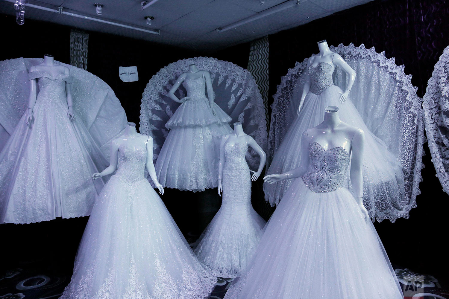 Wedding dresses on display in Lelte boutique on a street in Aden, Yemen. (AP Photo/Nariman El-Mofty)