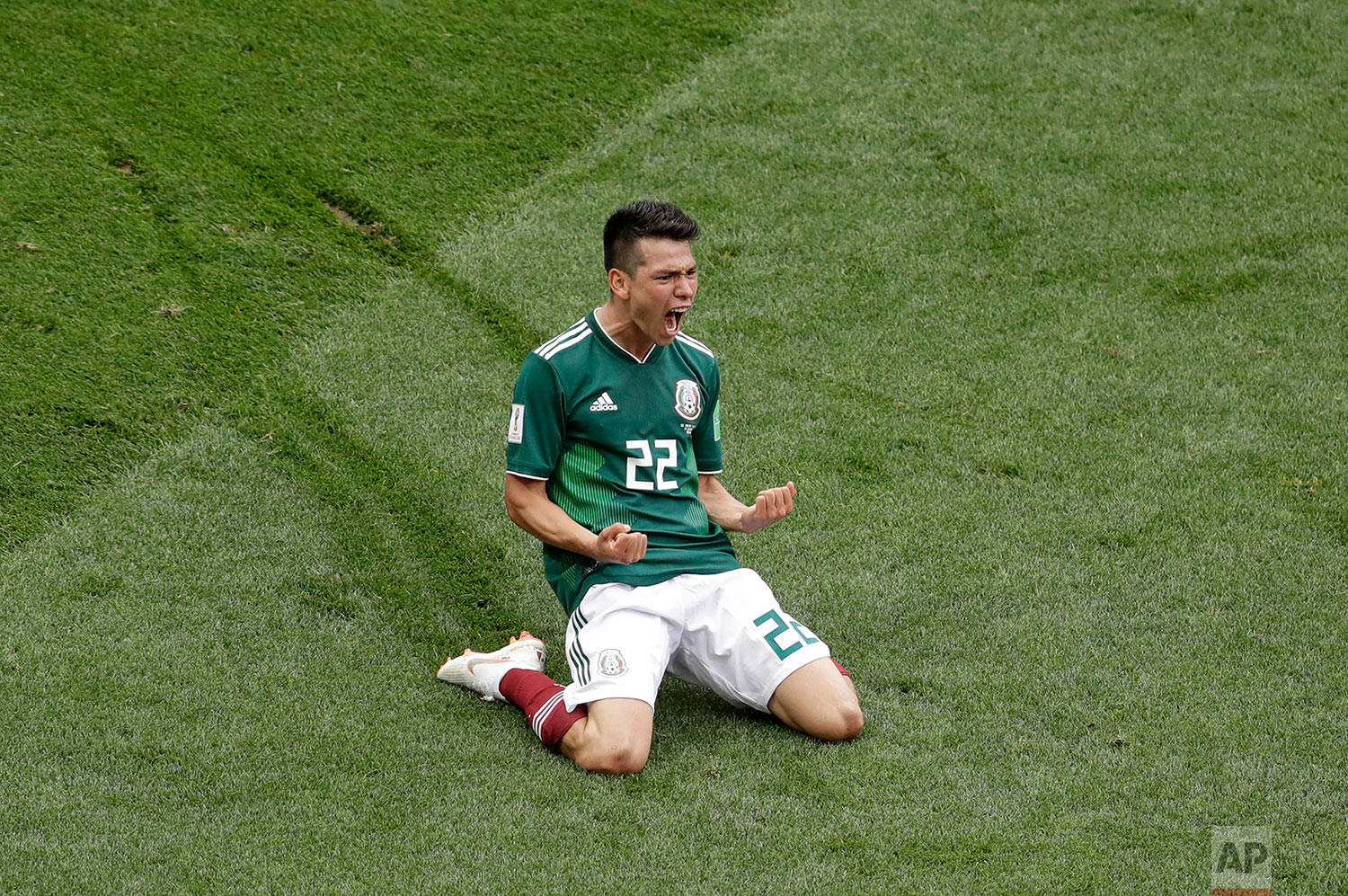 Mexico's Hirving Lozano celebrates after scoring the opening goal during the group F match between Germany and Mexico at the 2018 soccer World Cup in the Luzhniki Stadium in Moscow, Russia, Sunday, June 17, 2018. (AP Photo/Michael Probst)
