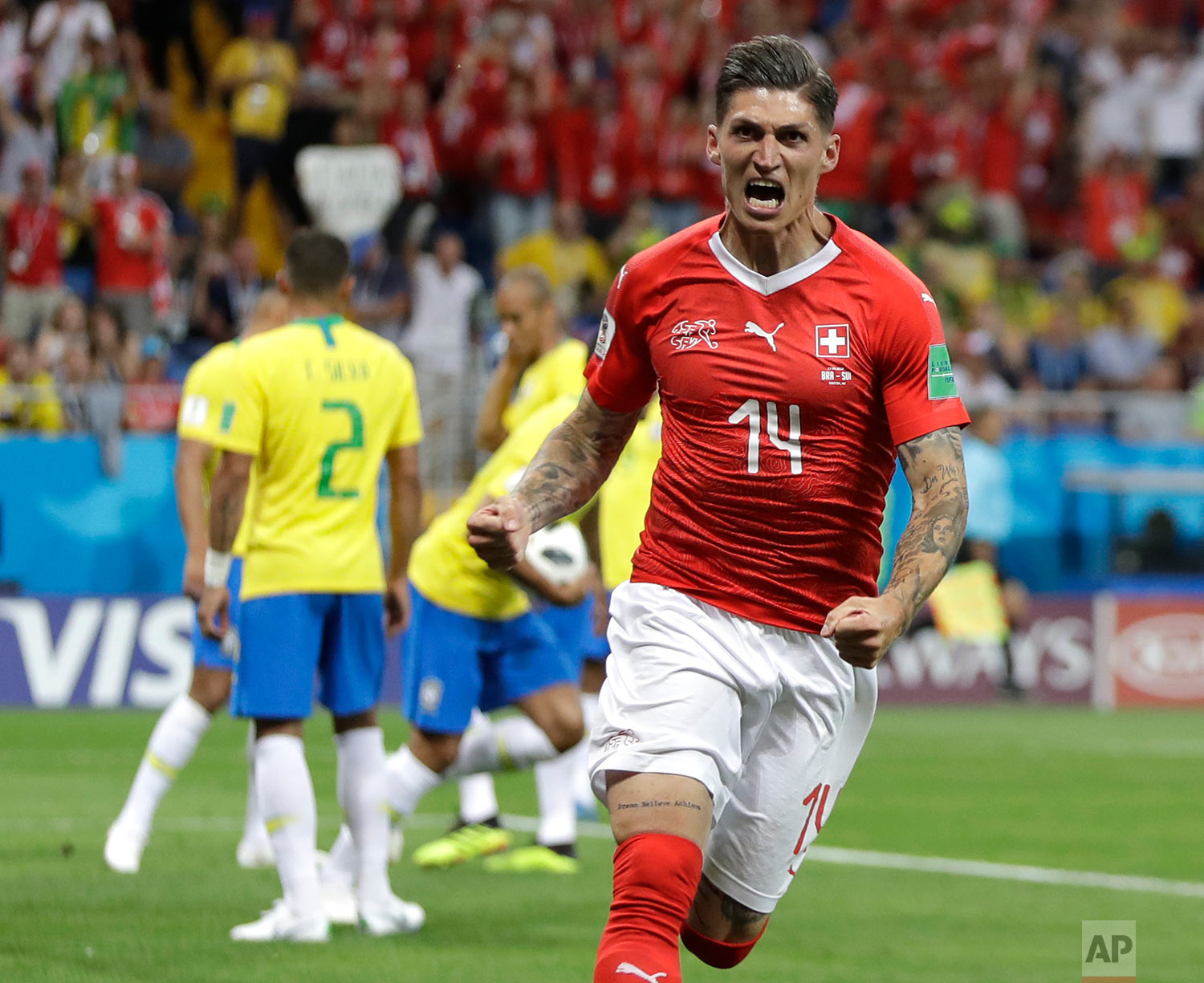 Switzerland's Steven Zuber celebrates after scoring his side's opening goal during the group E match between Brazil and Switzerland at the 2018 soccer World Cup in the Rostov Arena in Rostov-on-Don, Russia, Sunday, June 17, 2018. (AP Photo/Themba Hadebe)