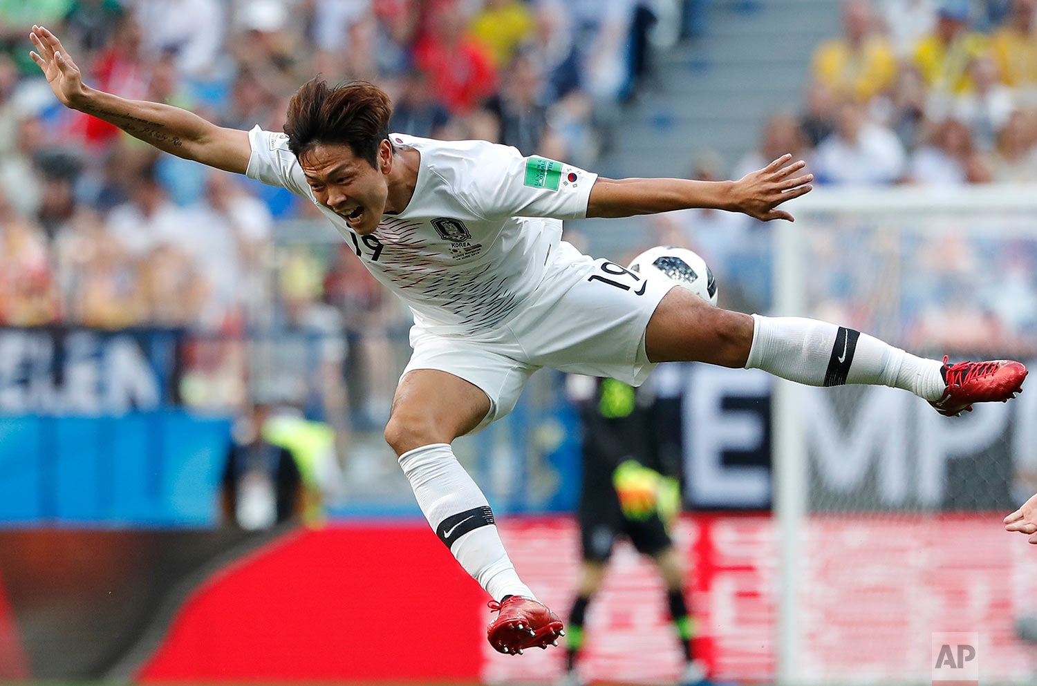 South Korea's Kim Young-gwon goes airborne during a challenge with Sweden's Marcus Berg during the group F match between Sweden and South Korea at the 2018 soccer World Cup in the Nizhny Novgorod stadium in Nizhny Novgorod, Russia, Monday, June 18, 2018. (AP Photo/Pavel Golovkin)