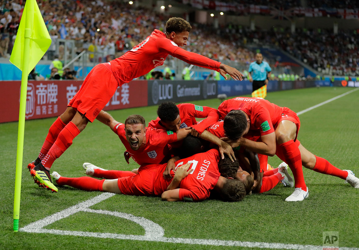 England's team celebrate after scoring their side's opening goal against Tunisia during the group G match between Tunisia and England at the 2018 soccer World Cup in the Volgograd Arena in Volgograd, Russia, Monday, June 18, 2018. (AP Photo/Sergei Grits)