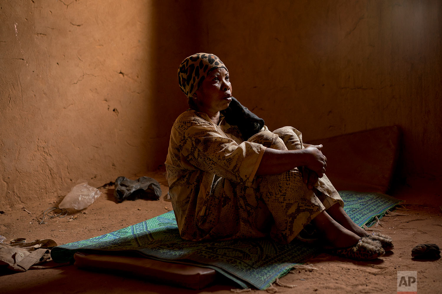 Janet Kamara, from Liberia, sits during an interview conducted in an IOM transit center in Arlit, Niger, on June 2, 2018. (AP Photo/Jerome Delay)