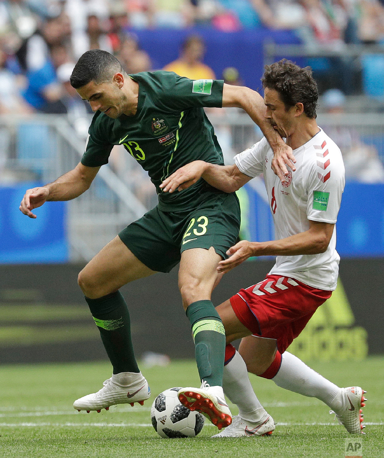 Australia's Tom Rogic, left, is challenged by Denmark's Thomas Delaney during the group C match between Denmark and Australia at the 2018 soccer World Cup in the Samara Arena in Samara, Russia, Thursday, June 21, 2018. (AP Photo/Gregorio Borgia)