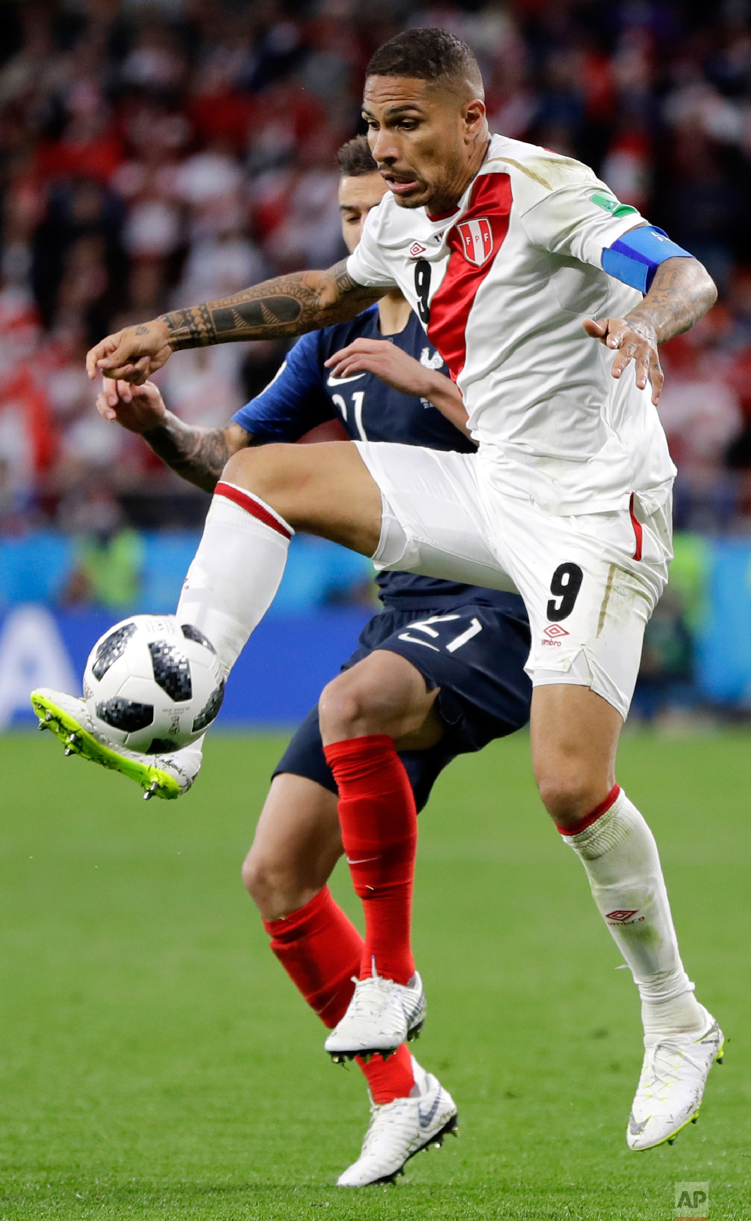 Peru's Paolo Guerrero is challenged by France's Lucas Hernandez, background, during the group C match between France and Peru at the 2018 soccer World Cup in the Yekaterinburg Arena in Yekaterinburg, Russia, Thursday, June 21, 2018. (AP Photo/Natacha Pisarenko)