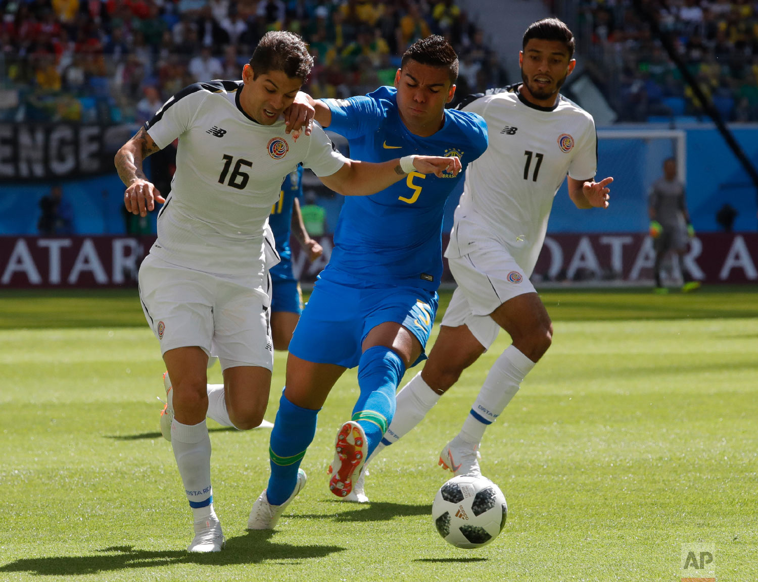 Costa Rica's Cristian Gamboa, left, and Brazil's Casemiro challenge for the ball during the group E match between Brazil and Costa Rica at the 2018 soccer World Cup in the St. Petersburg Stadium in St. Petersburg, Russia, Friday, June 22, 2018. (AP Photo/Dmitri Lovetsky)