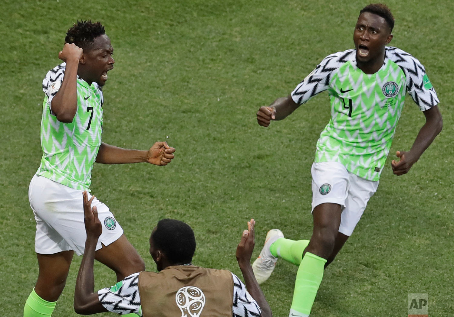 Nigeria's Ahmed Musa, left, celebrates with teammates after scoring his side's opening goal during the group D match between Nigeria and Iceland at the 2018 soccer World Cup in the Volgograd Arena in Volgograd, Russia, Friday, June 22, 2018. (AP Photo/Themba Hadebe)