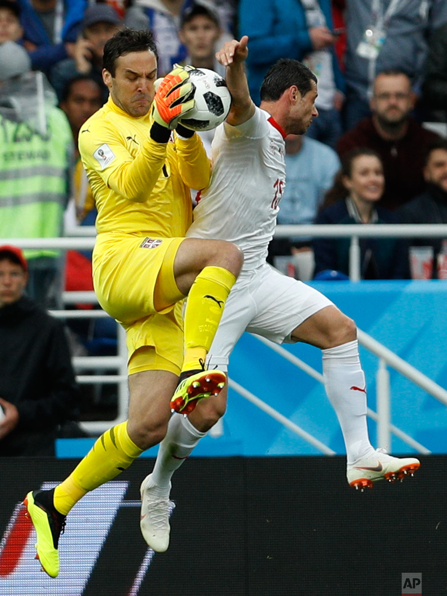 Serbia goalkeeper Vladimir Stojkovic cuts off a shot during the group E match between Switzerland and Serbia at the 2018 soccer World Cup in the Kaliningrad Stadium in Kaliningrad, Russia, Friday, June 22, 2018. (AP Photo/Victor Caivano)