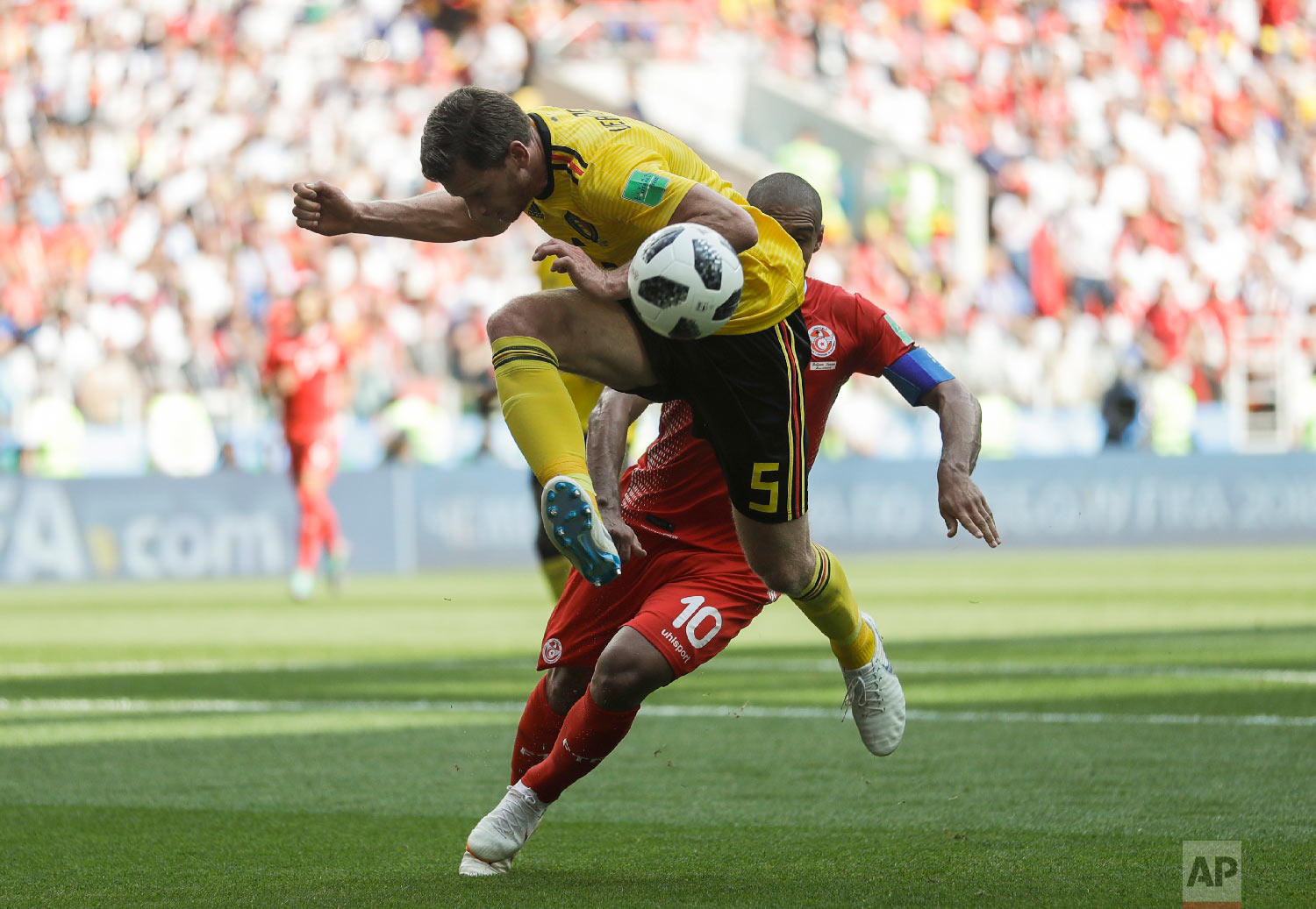Belgium's Jan Vertonghen, top, and Tunisia's Wahbi Khazri challenge for the ball during the group G match between Belgium and Tunisia at the 2018 soccer World Cup in the Spartak Stadium in Moscow, Russia, Saturday, June 23, 2018. (AP Photo/Matthias Schrader)