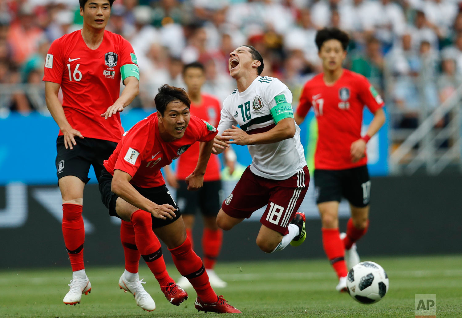 Mexico's Andres Guardado, right, challenges for the ball with South Korea's Kim Young-gwon during the group F match between Mexico and South Korea at the 2018 soccer World Cup in the Rostov Arena in Rostov-on-Don, Russia, Saturday, June 23, 2018. (AP Photo/Eduardo Verdugo)