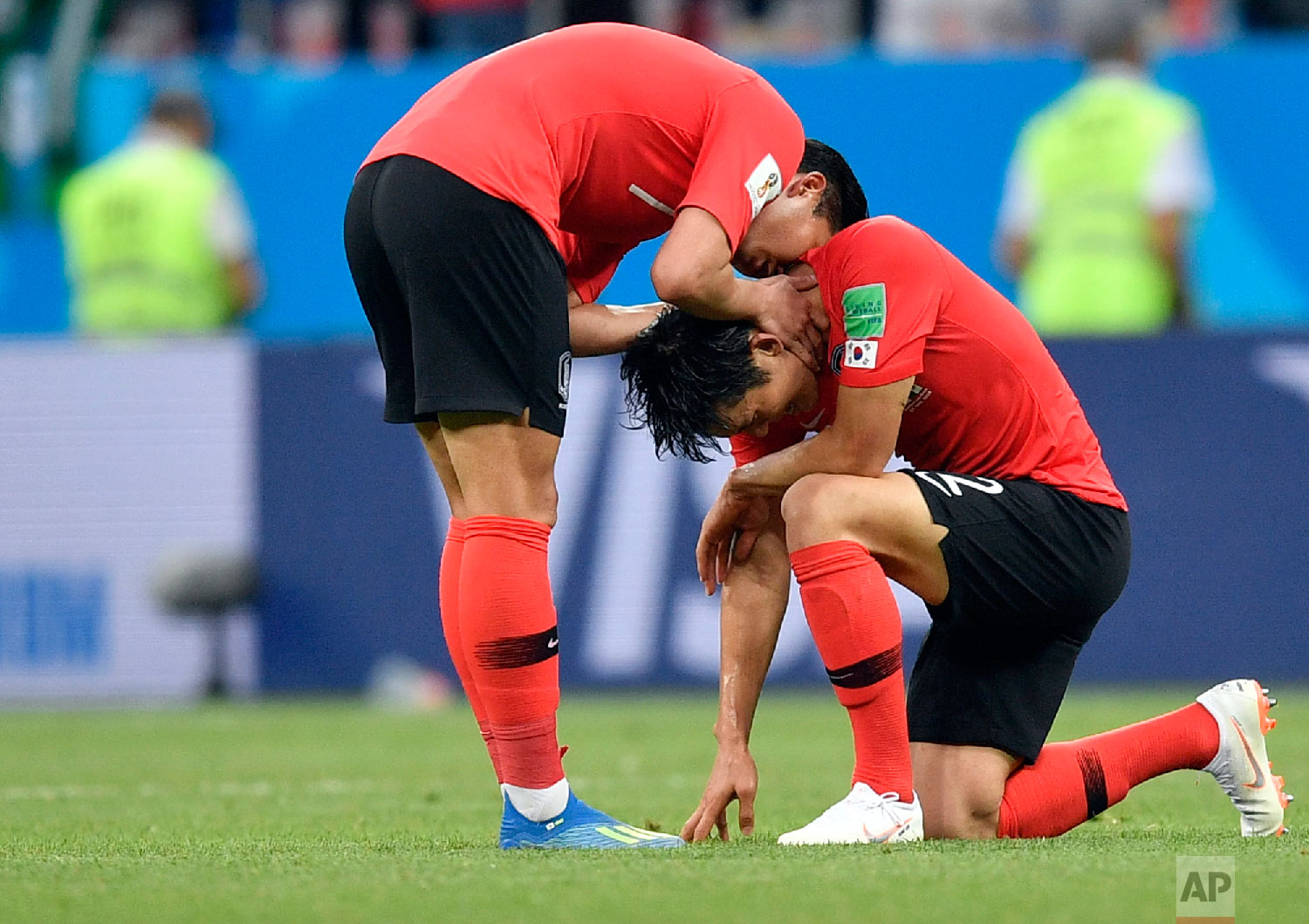 South Korea players console each others at the end of the group F match between Mexico and South Korea at the 2018 soccer World Cup in the Rostov Arena in Rostov-on-Don, Russia, Saturday, June 23, 2018. Mexico won 2-1. (AP Photo/Martin Meissner)