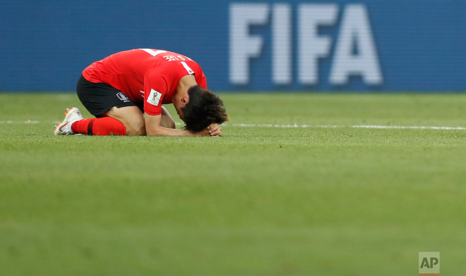 South Korea'sLeeJae-sung lies on the pitch at the end of the group F match between Mexico and South Korea at the 2018 soccer World Cup in the Rostov Arena in Rostov-on-Don, Russia, Saturday, June 23, 2018. (AP Photo/Eduardo Verdugo)
