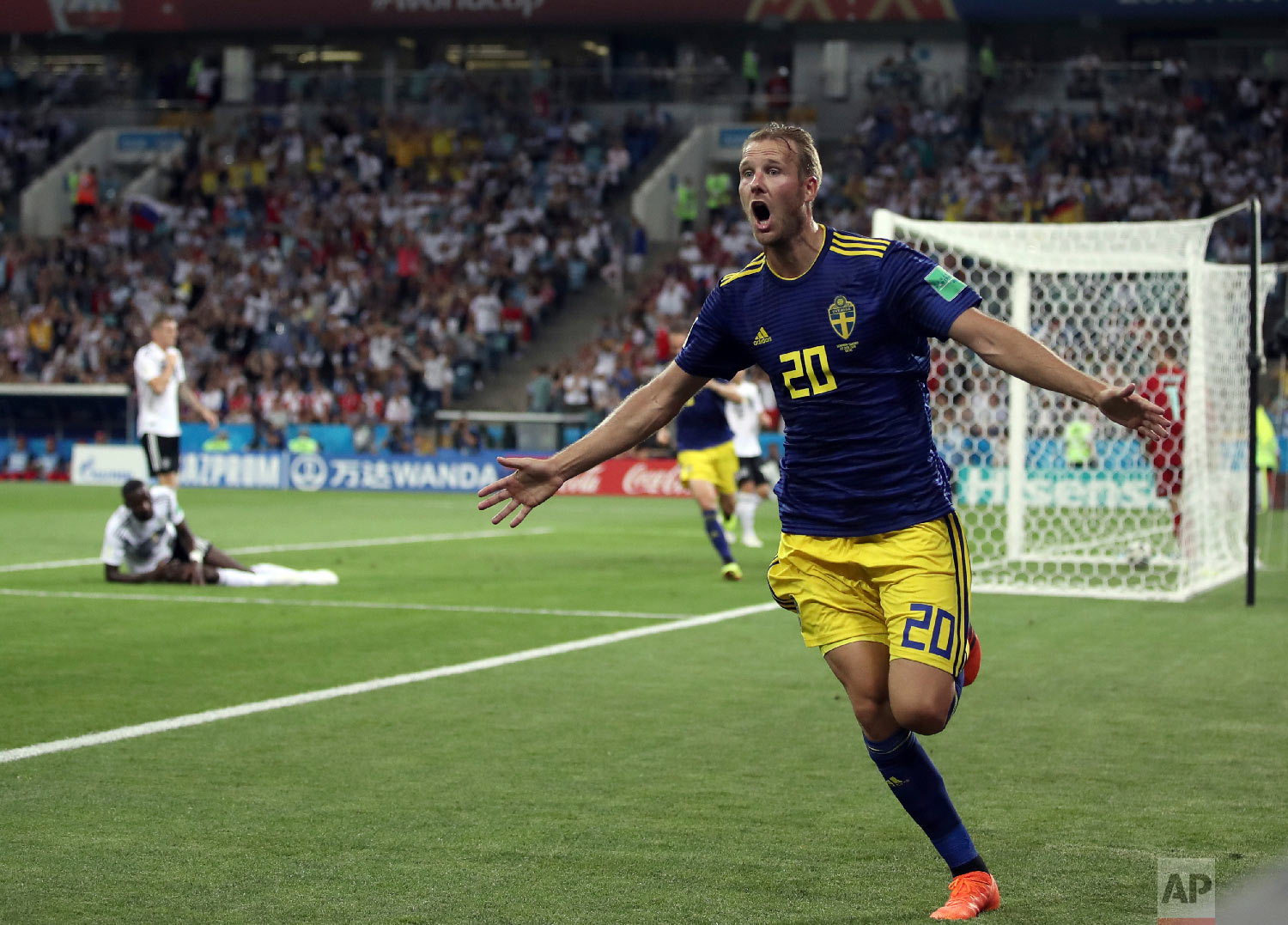 Sweden's Ola Toivonen celebrates after scoring his side's opening goal during the group F match between Germany and Sweden at the 2018 soccer World Cup in the Fisht Stadium in Sochi, Russia, Saturday, June 23, 2018. (AP Photo/Thanassis Stavrakis)