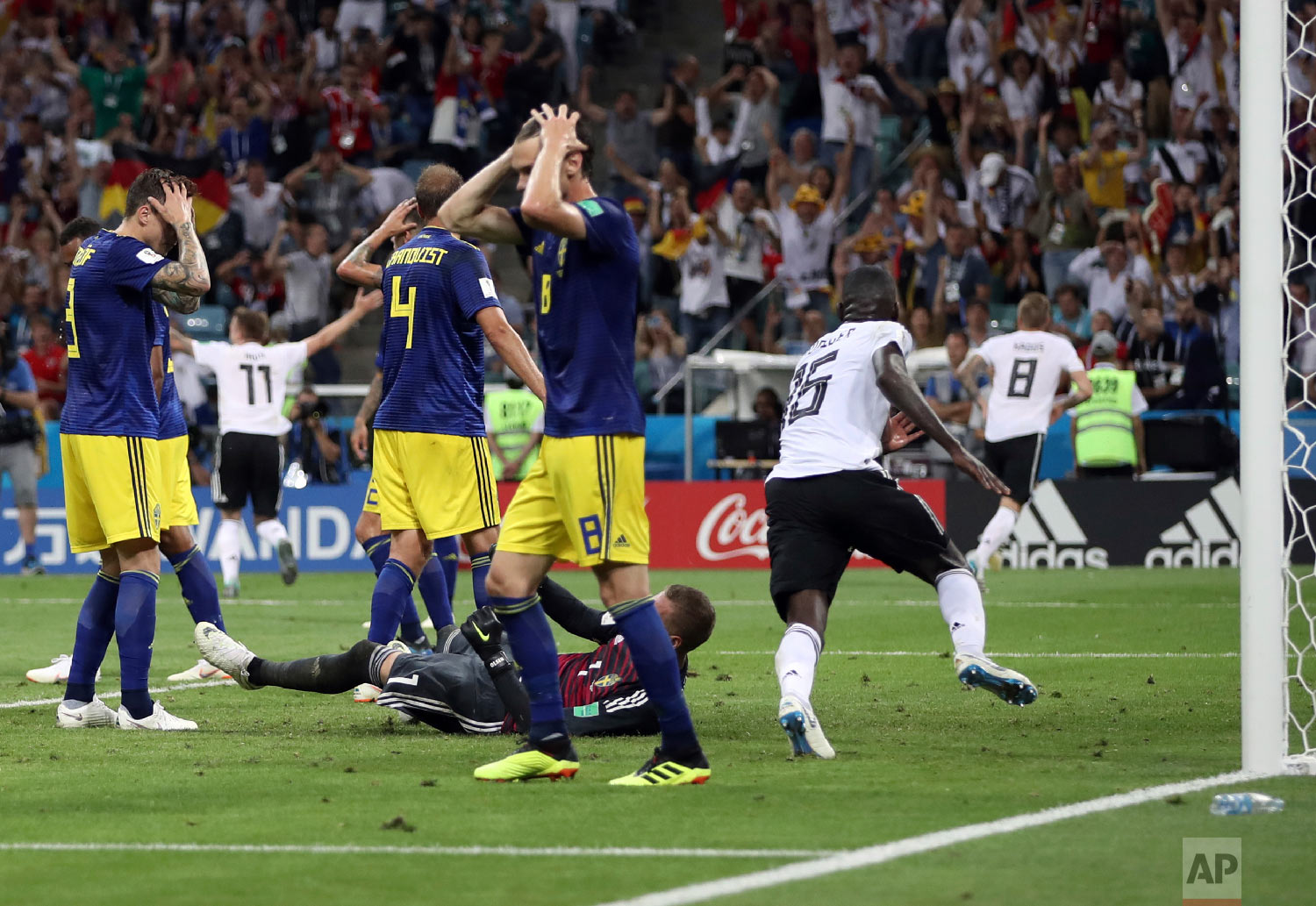 Sweden players reacts after Germany's Toni Kroos, right, scores his side's second goal during the group F match between Germany and Sweden at the 2018 soccer World Cup in the Fisht Stadium in Sochi, Russia, Saturday, June 23, 2018. (AP Photo/Thanassis Stavrakis)