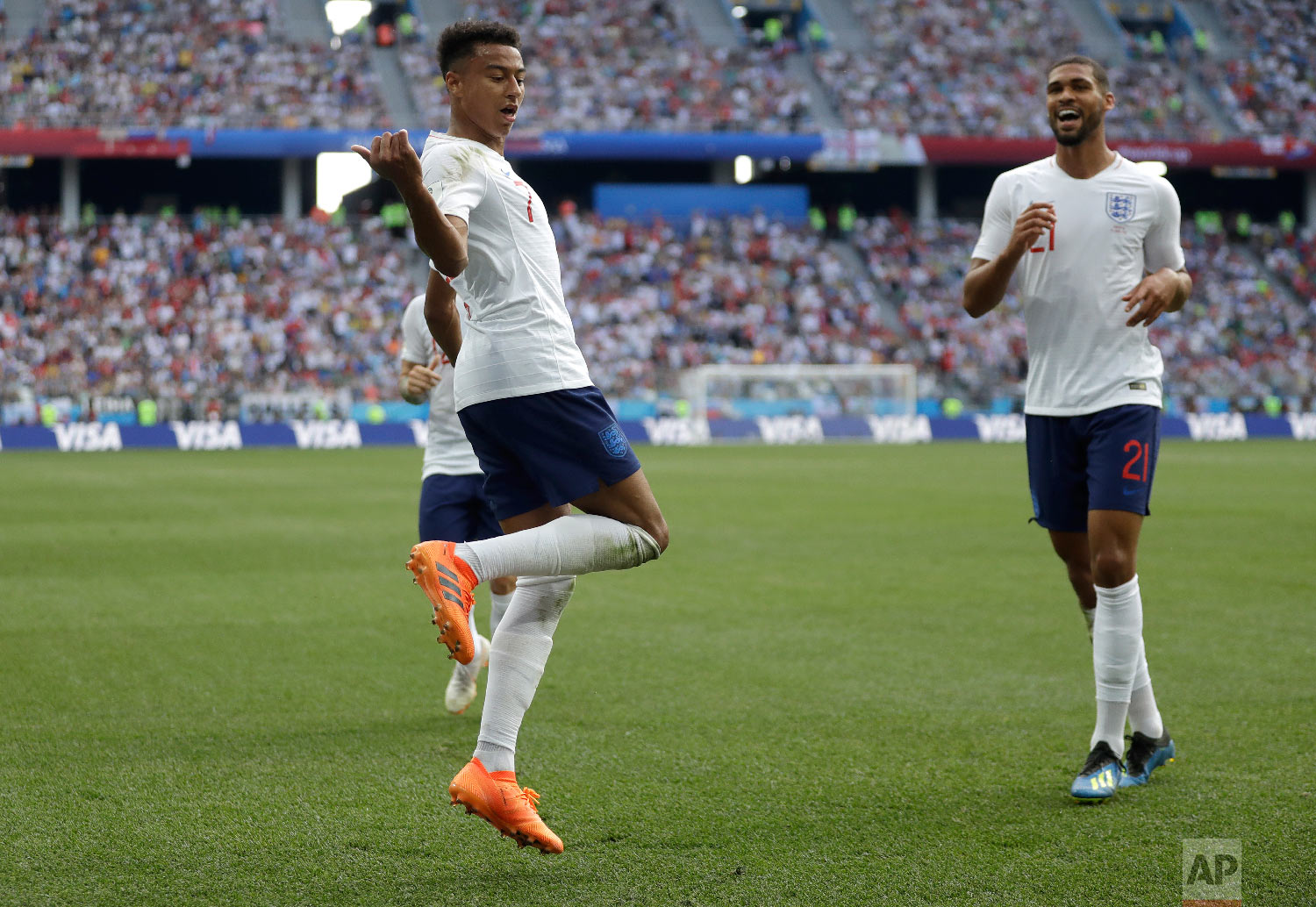 England's Jesse Lingard reacts as he celebrates after scoring his team's third goal during the group G match between England and Panama at the 2018 soccer World Cup at the Nizhny Novgorod Stadium in Nizhny Novgorod , Russia, Sunday, June 24, 2018. (AP Photo/Matthias Schrader)