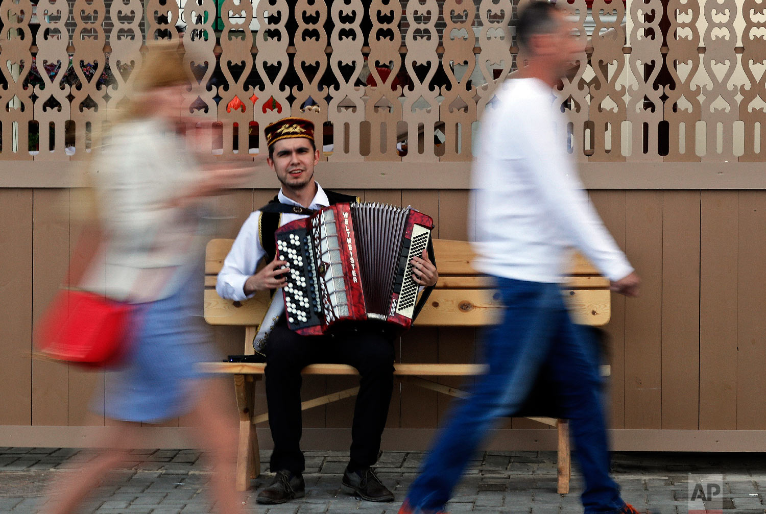 A street musician plays the accordion during the 2018 soccer World Cup in Kazan the capital of the Republic of Tatarstan, Russia on June 21, 2018. (AP Photo/Frank Augstein)