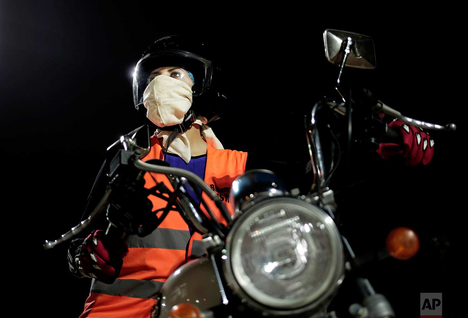 In this June 23, 2018 photo, Maha Mohammed poses for a photograph, on a motorbike as she learns how to ride, at the Bikers Skills Institute, in Riyadh, Saudi Arabia. (AP Photo/Nariman El-Mofty)
