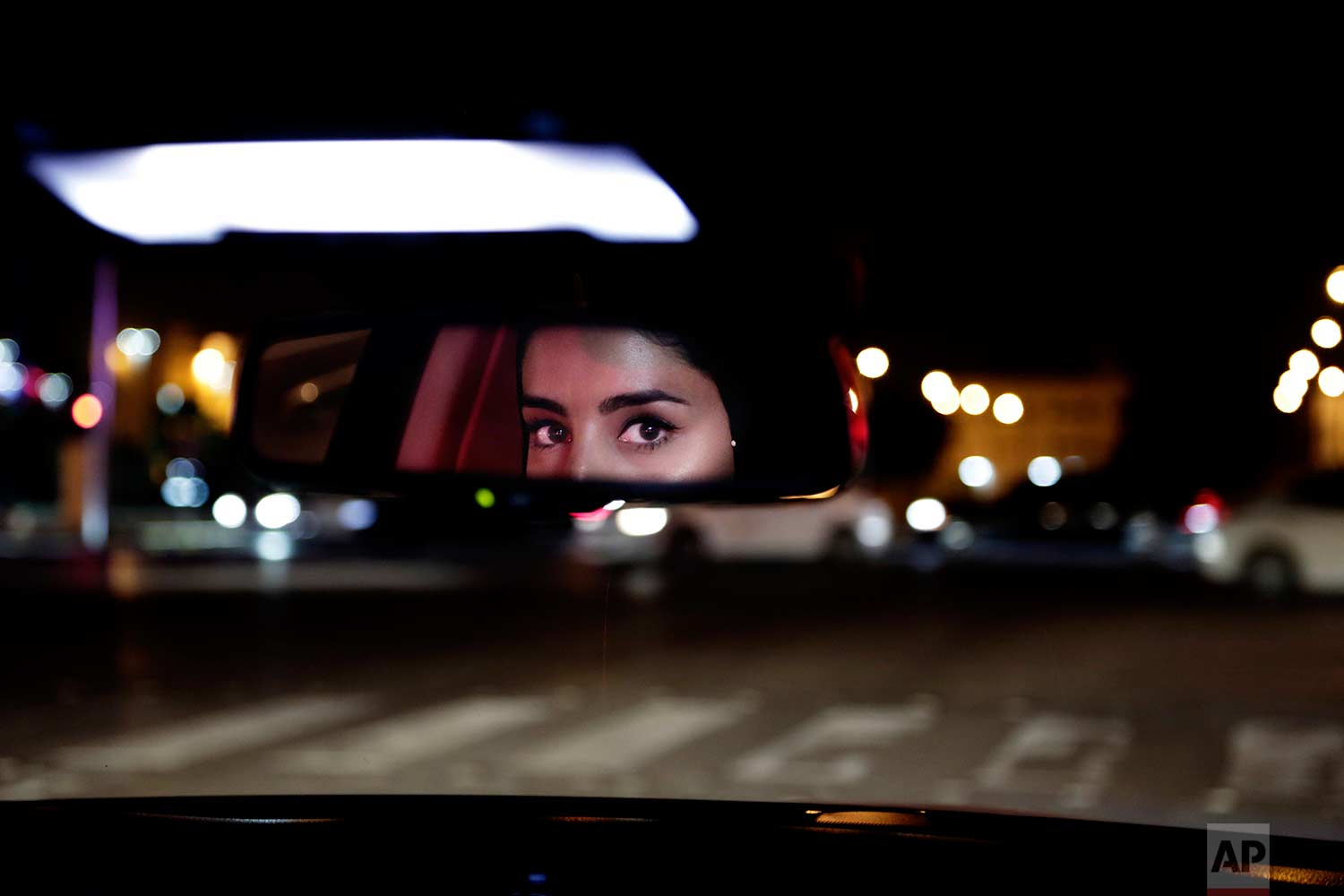 In this Sunday, June 24, 2018 photo, Hessah al-Ajaji drives her car down the capital's busy Tahlia Street after midnight for the first time, in Riyadh, Saudi Arabia. (AP Photo/Nariman El-Mofty)