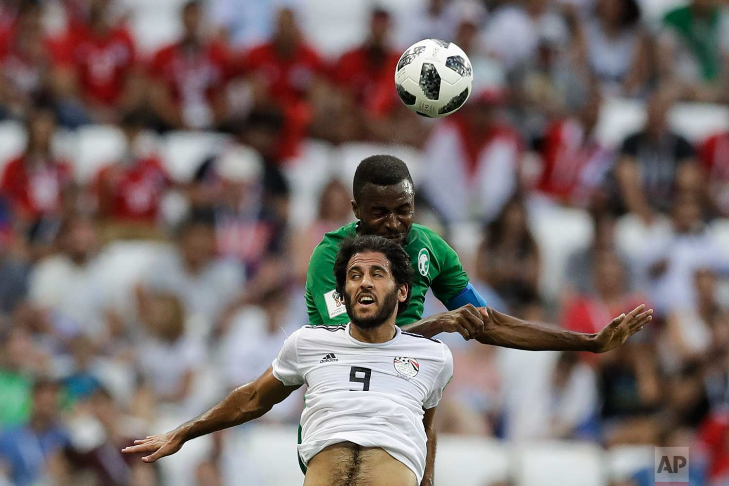 Egypt's Marwan Mohsen, front, and Saudi Arabia's Osama Hawsawi jump for the ball during the group A match between Saudi Arabia and Egypt at the 2018 soccer World Cup at the Volgograd Arena in Volgograd, Russia, Monday, June 25, 2018. (AP Photo/Andrew Medichini)