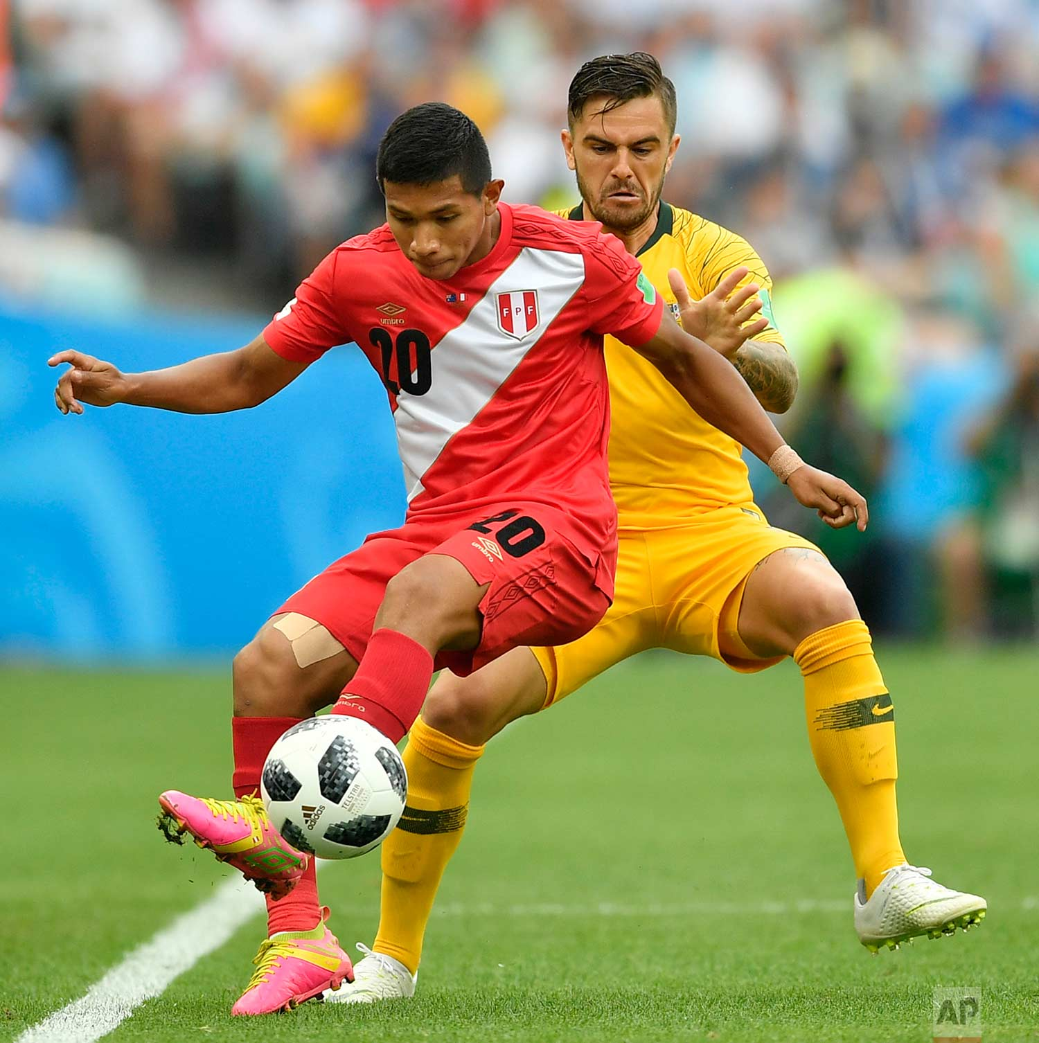 Peru's Edison Flores, left, and Australia's Joshua Risdon challenge for the ball during the group C match between Australia and Peru, at the 2018 soccer World Cup in the Fisht Stadium in Sochi, Russia, Tuesday, June 26, 2018. (AP Photo/Martin Meissner)