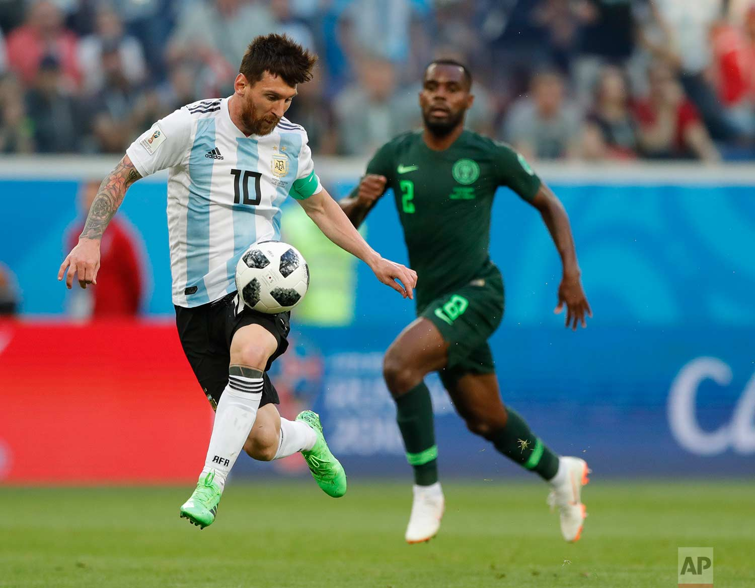 Argentina's Lionel Messi controls the ball during the group D match between Argentina and Nigeria, at the 2018 soccer World Cup in the St. Petersburg Stadium in St. Petersburg, Russia, Tuesday, June 26, 2018. (AP Photo/Ricardo Mazalan)