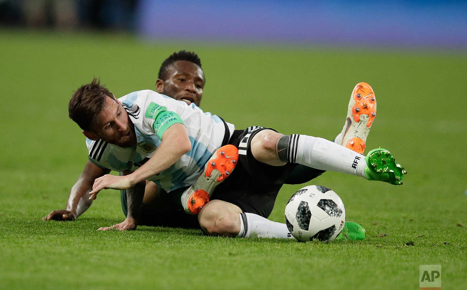 Argentina's Lionel Messi, foreground, and Nigeria's John Obi Mikel compete for the ball during the group D match between Argentina and Nigeria at the 2018 soccer World Cup in the St. Petersburg Stadium in St. Petersburg, Russia, Tuesday, June 26, 2018. (AP Photo/Dmitri Lovetsky)