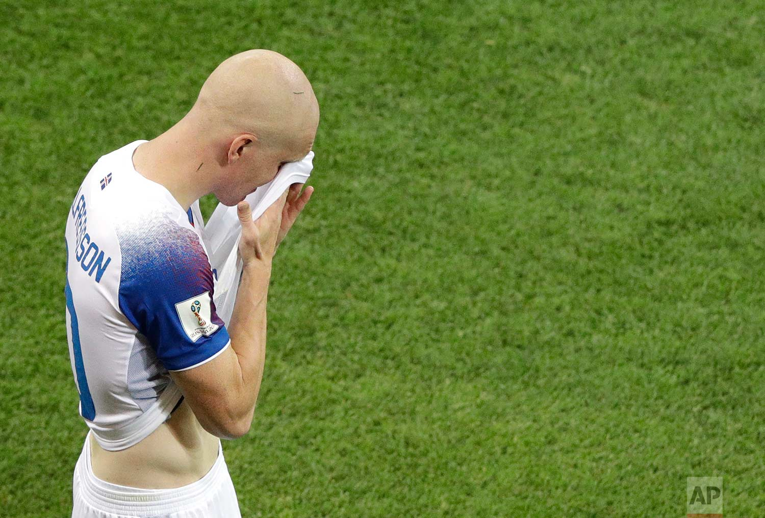 Iceland's Emil Hallfredsson wipes his face at the end of the group D match between Iceland and Croatia, at the 2018 soccer World Cup in the Rostov Arena in Rostov-on-Don, Russia, Tuesday, June 26, 2018. (AP Photo/Mark Baker)