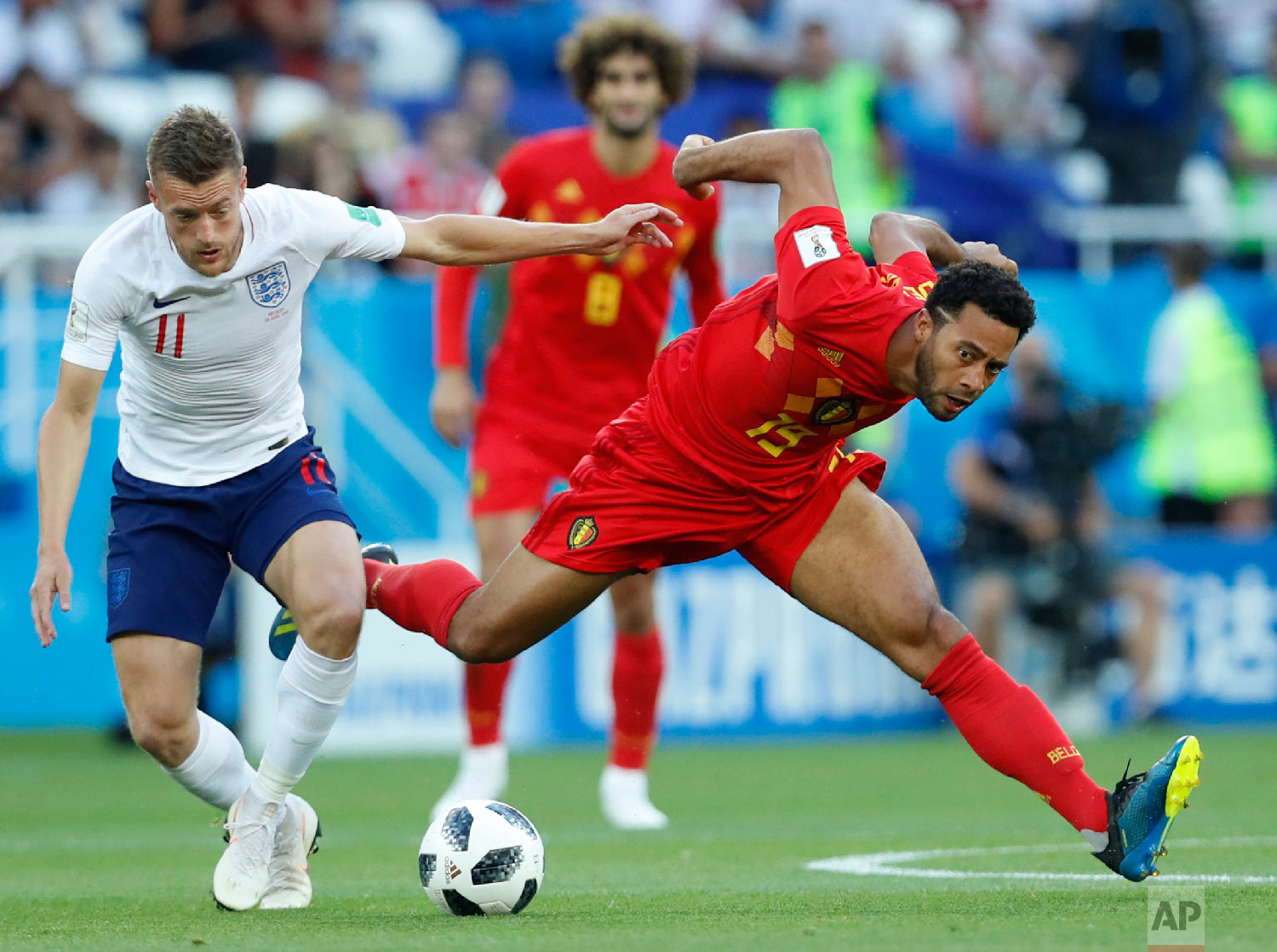 England's Jamie Vardy, left, and Belgium's Moussa Dembele challenge for the ball during the group G match between England and Belgium at the 2018 soccer World Cup in the Kaliningrad Stadium in Kaliningrad, Russia, Thursday, June 28, 2018. (AP Photo/Hassan Ammar)