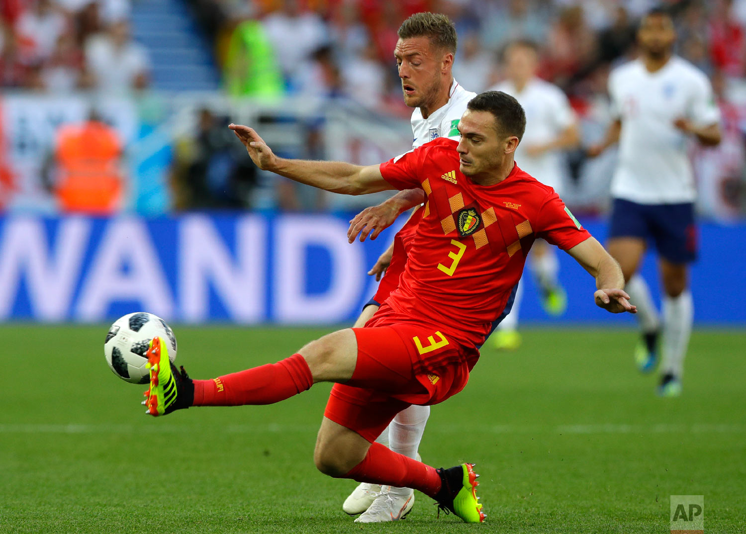 England's Jamie Vardy vies for the ball with Belgium's Thomas Vermaelen, right, during the group G match between England and Belgium at the 2018 soccer World Cup in the Kaliningrad Stadium in Kaliningrad, Russia, Thursday, June 28, 2018. (AP Photo/Alastair Grant)