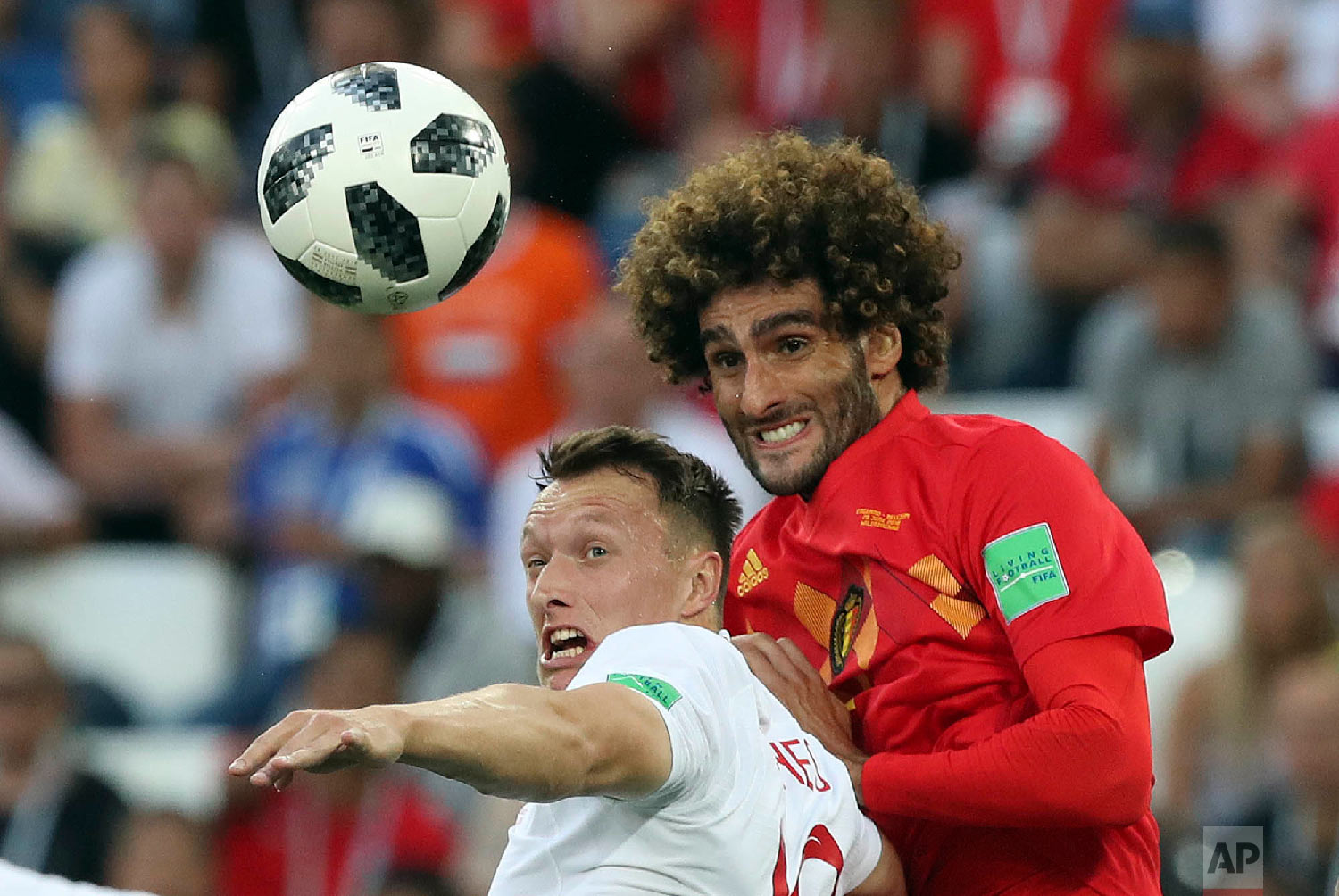 England's Ashley Young, left, and Belgium's Marouane Fellaini challenge for the ball during the group G match between England and Belgium at the 2018 soccer World Cup in the Kaliningrad Stadium in Kaliningrad, Russia, Thursday, June 28, 2018. (AP Photo/Czarek Sokolowski)