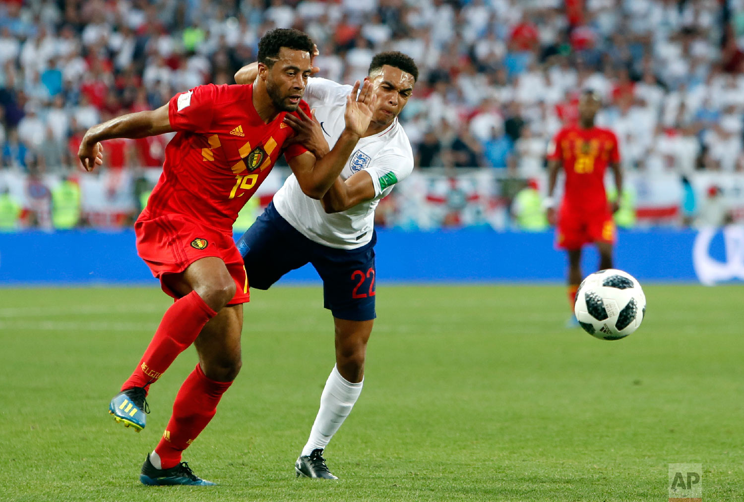 Belgium's Moussa Dembele vies for the ball with England's Trent Alexander-Arnold, right, during the group G match between England and Belgium at the 2018 soccer World Cup in the Kaliningrad Stadium in Kaliningrad, Russia, Thursday, June 28, 2018. (AP Photo/Alastair Grant)